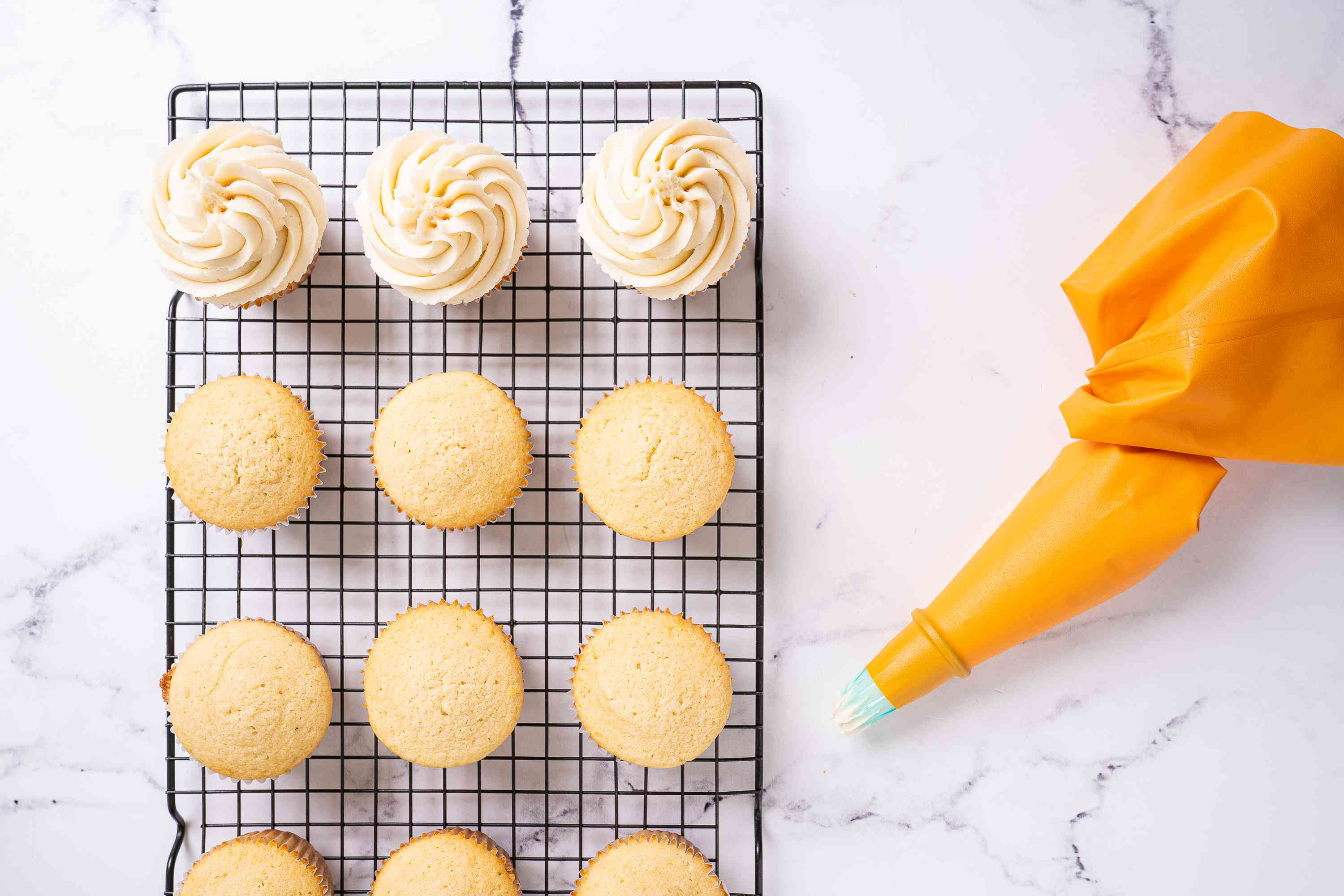 Decorating cupcakes with piping bag