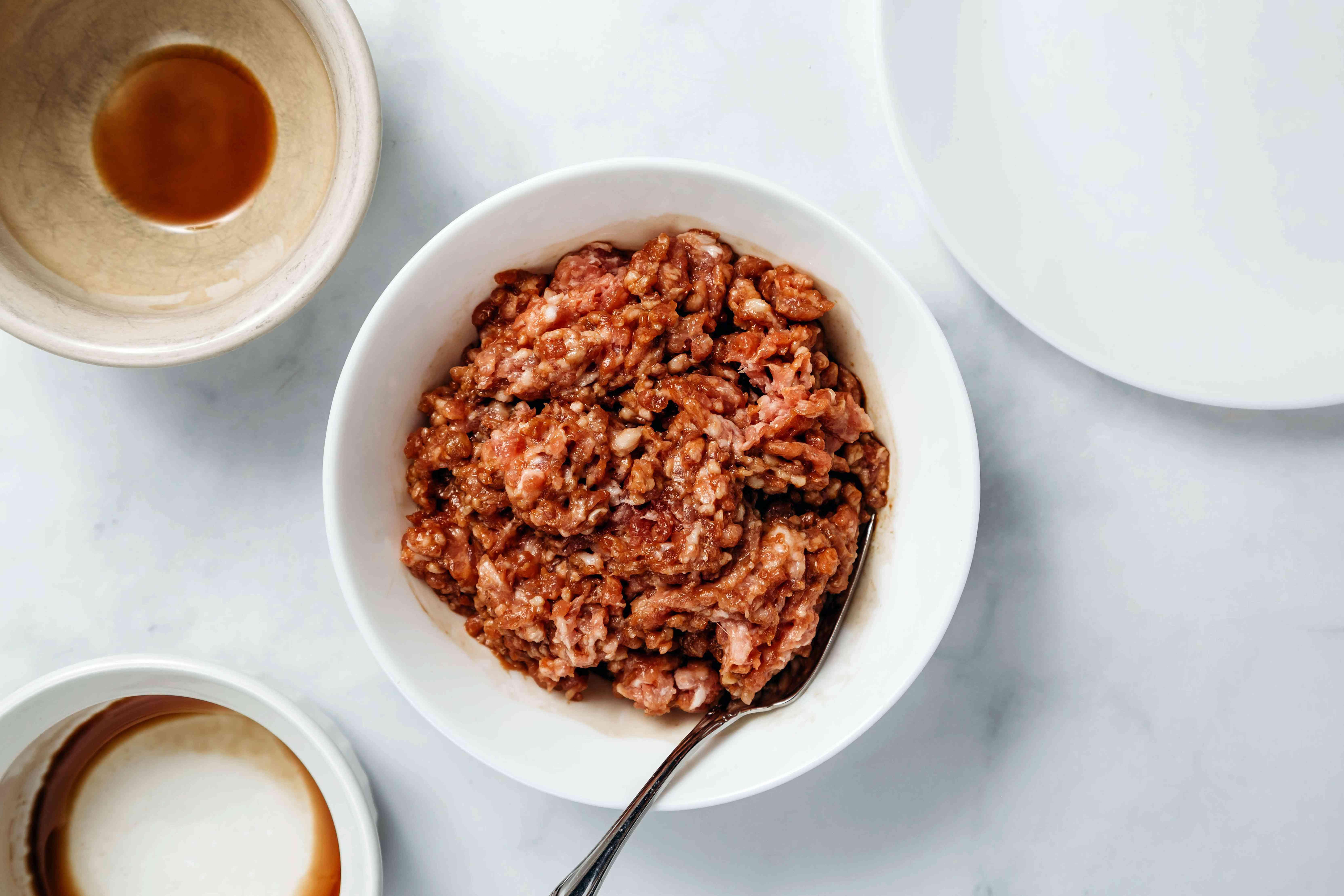 Marinate pork in a bowl