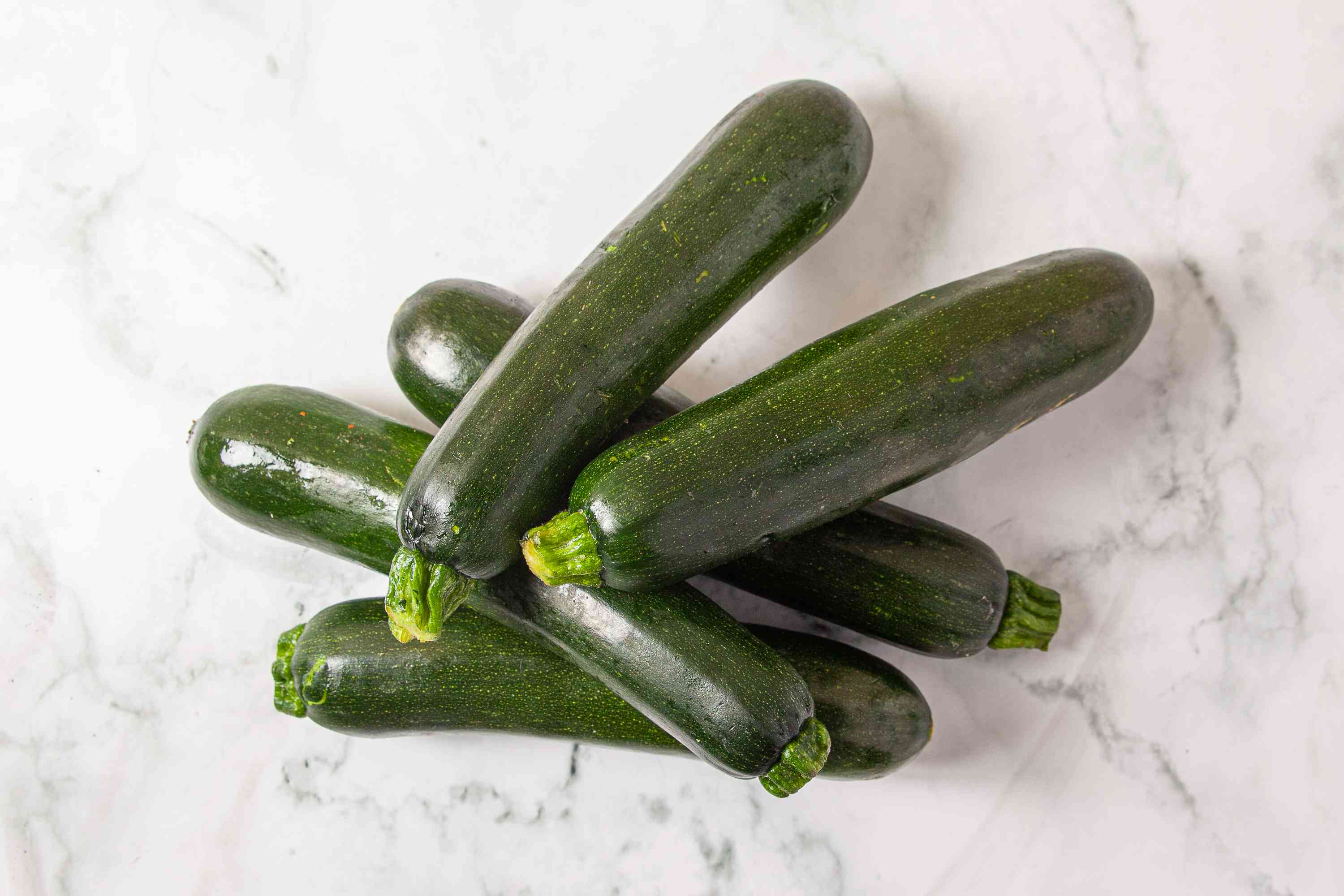 Fresh zucchini on a marble counter