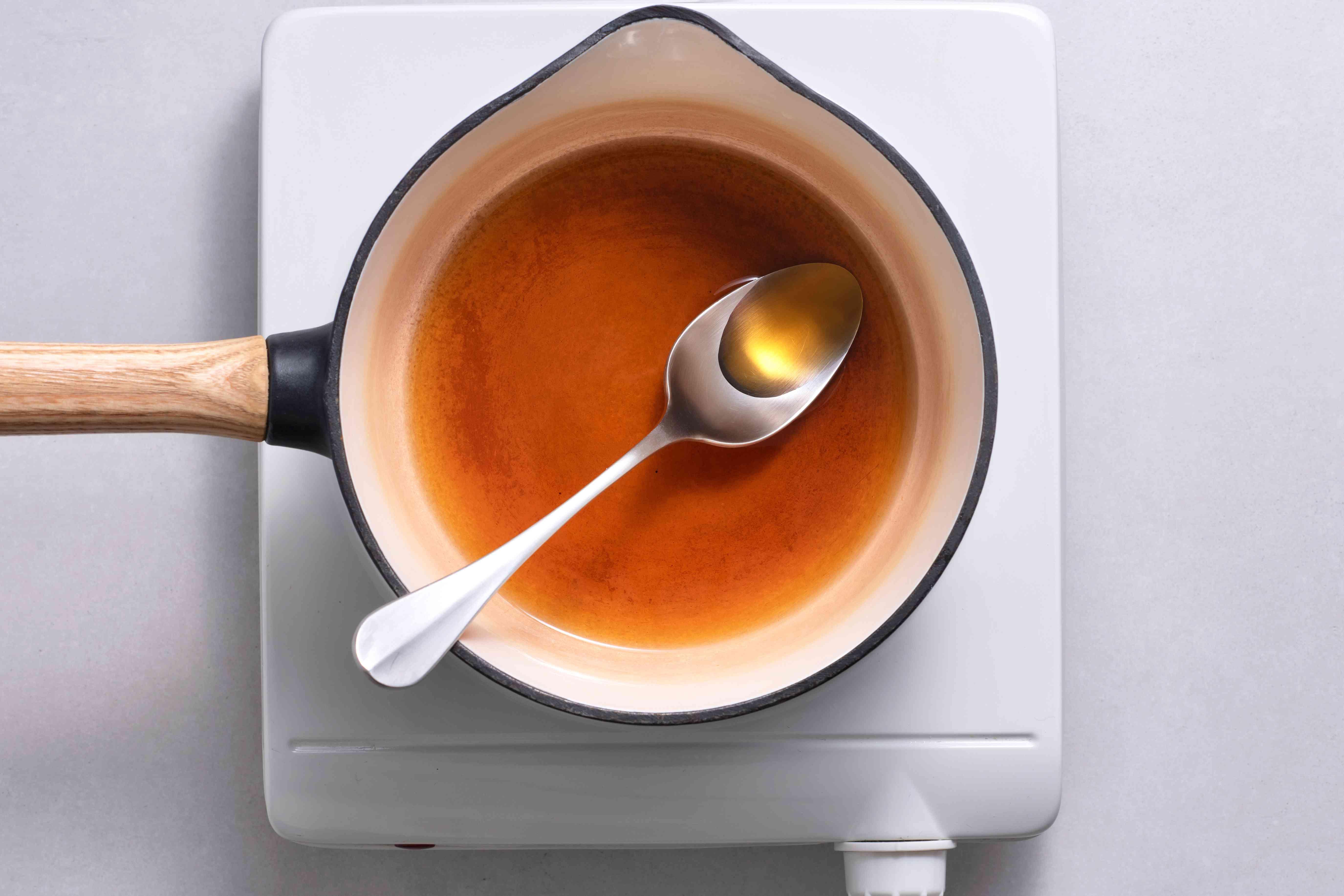 In a medium saucepan, combine water and brown sugar