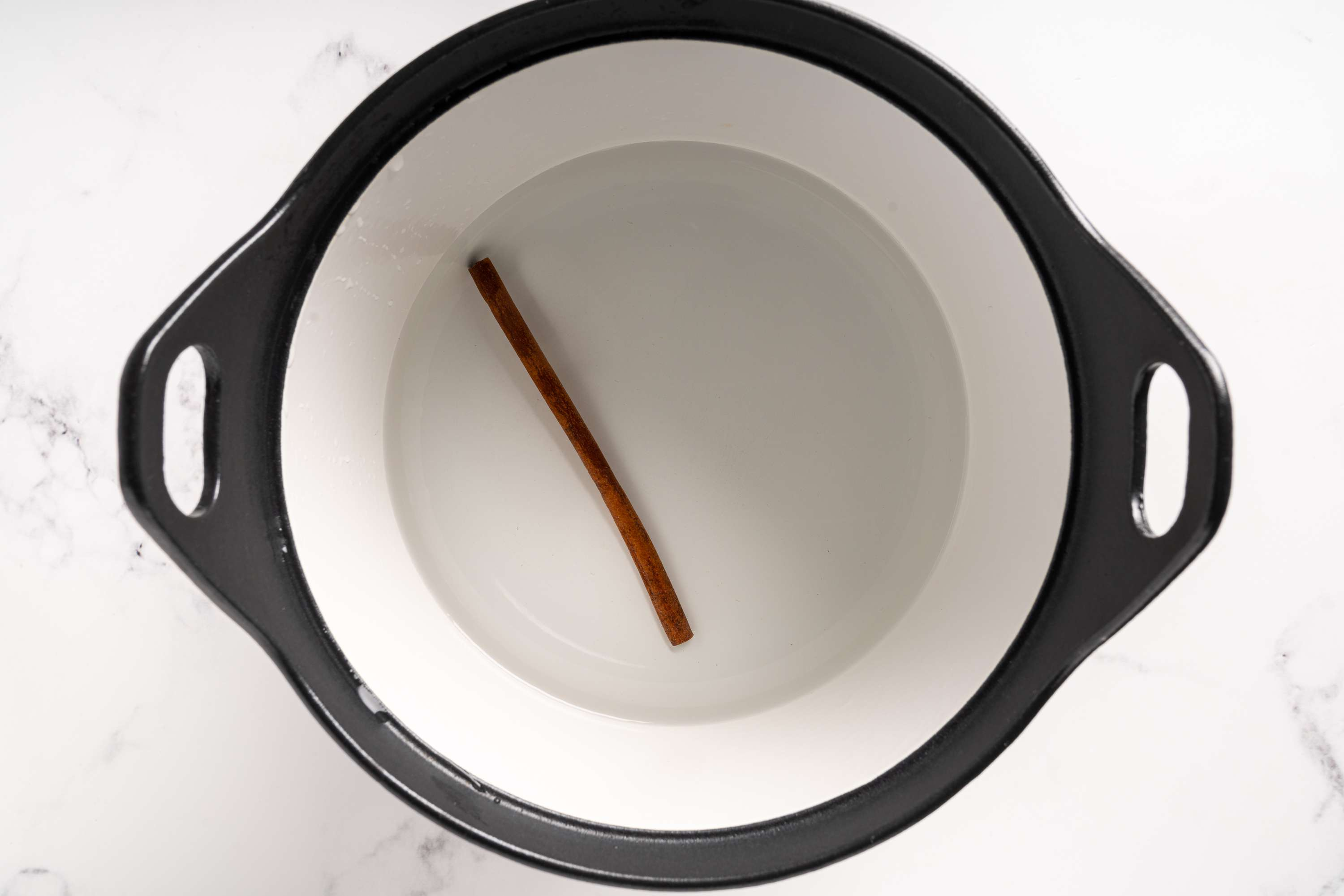 water and cinnamon in a pot