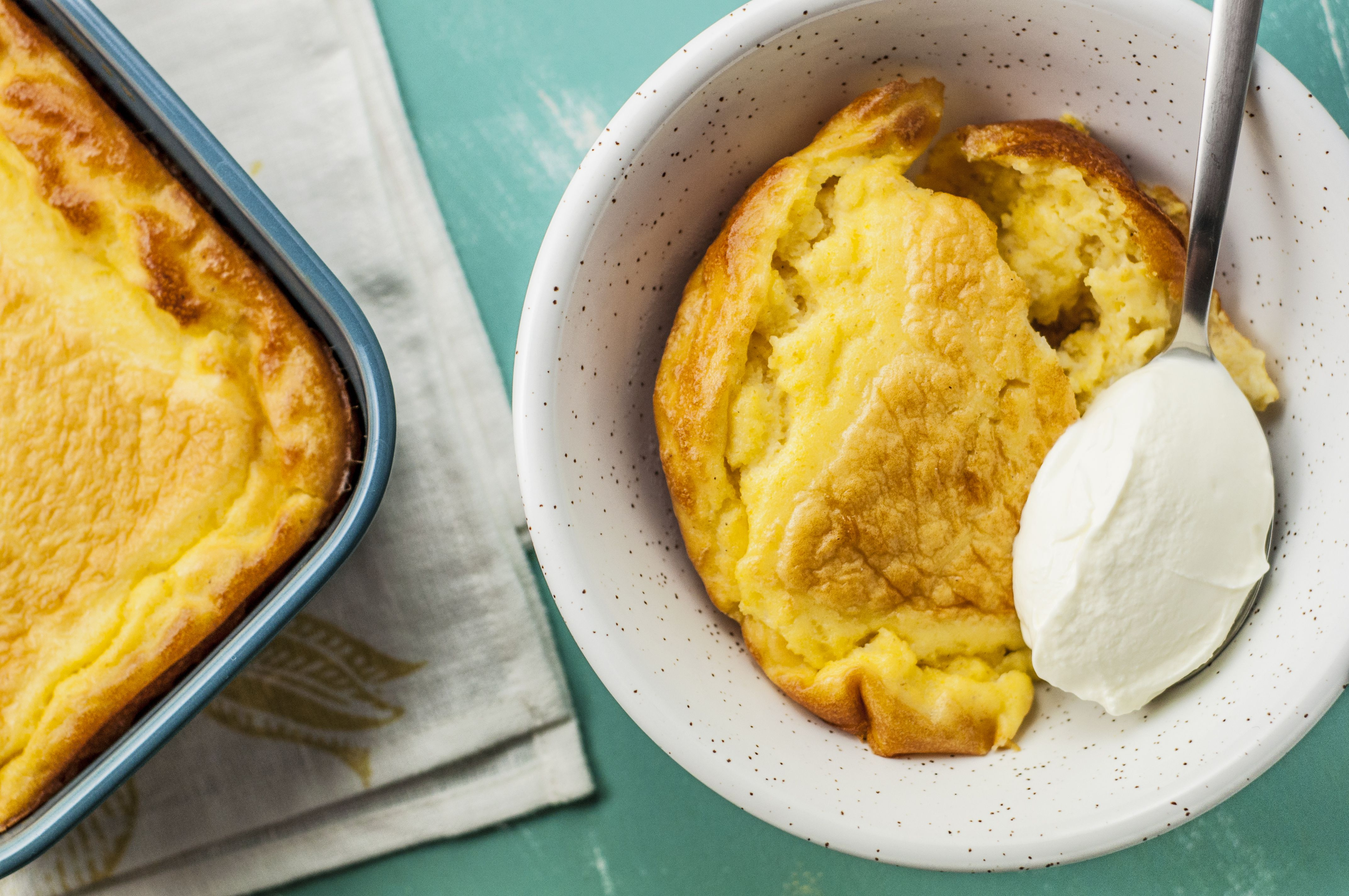 Serving Southern spoon bread in a bowl with butter