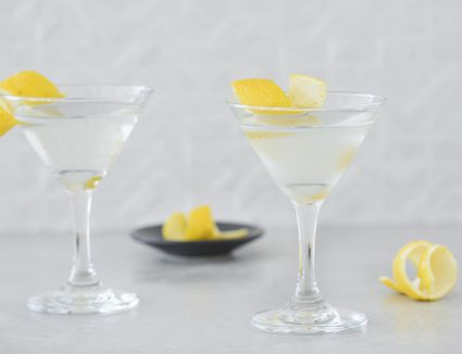 Classic gin martini garnished with lemon twists