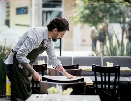 waiter wiping down table