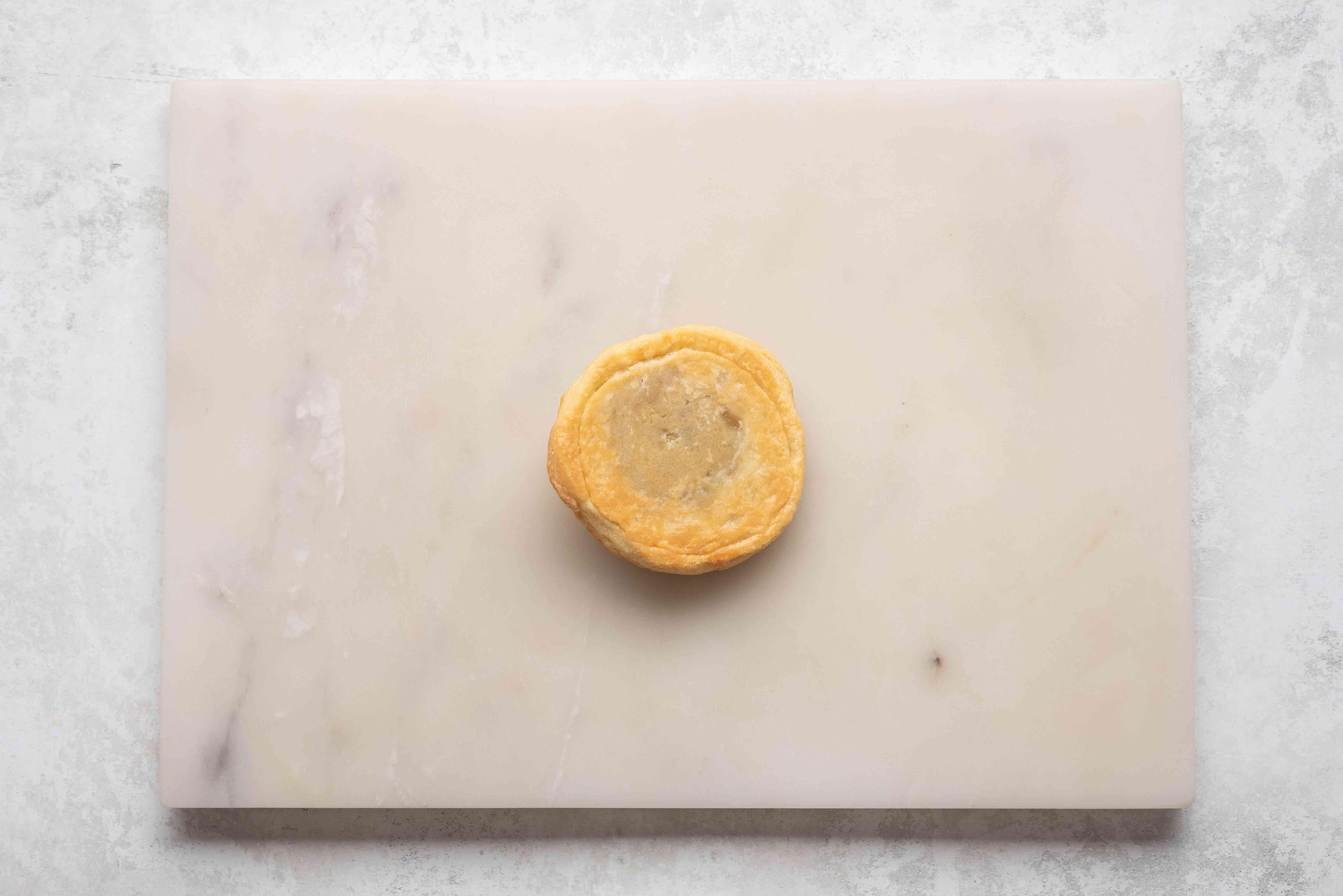 mini pie on cutting board