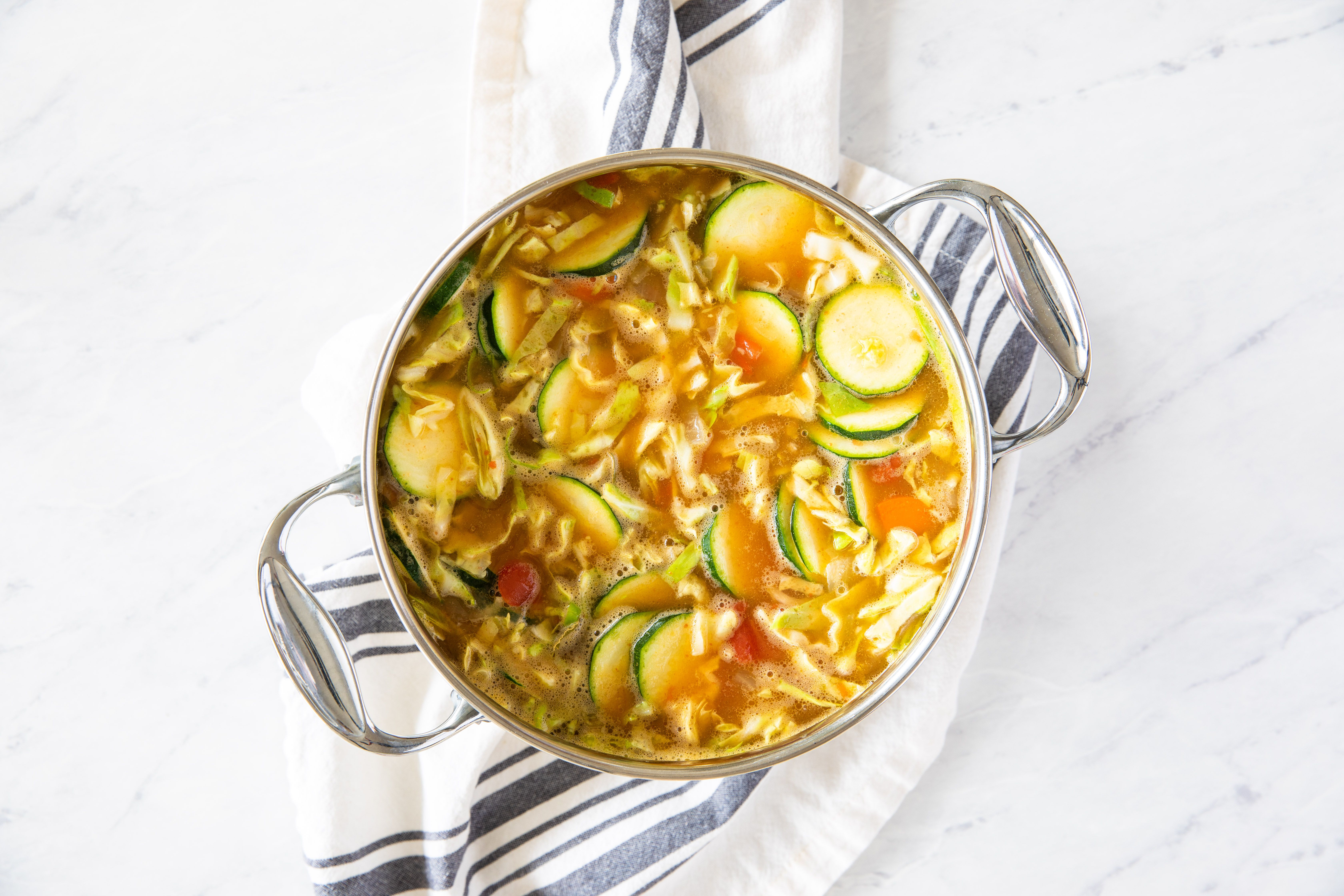 Carefully add in vegetable broth