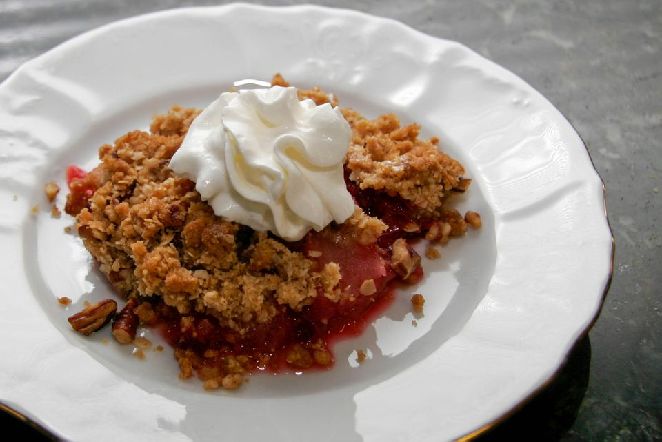 apple cranberry crisp dessert with whipped cream