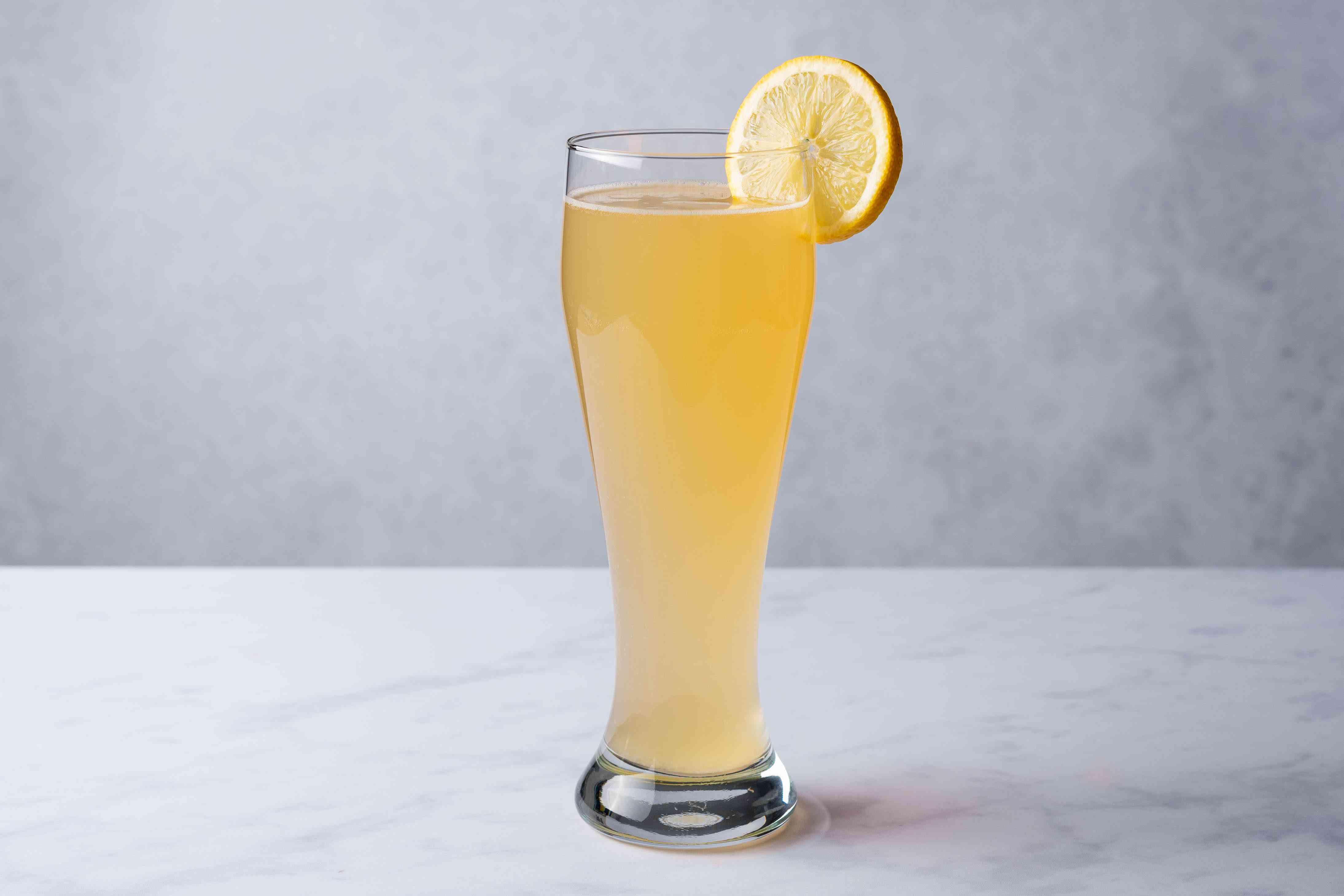 Easy Summer Shandy garnished with a lemon slice