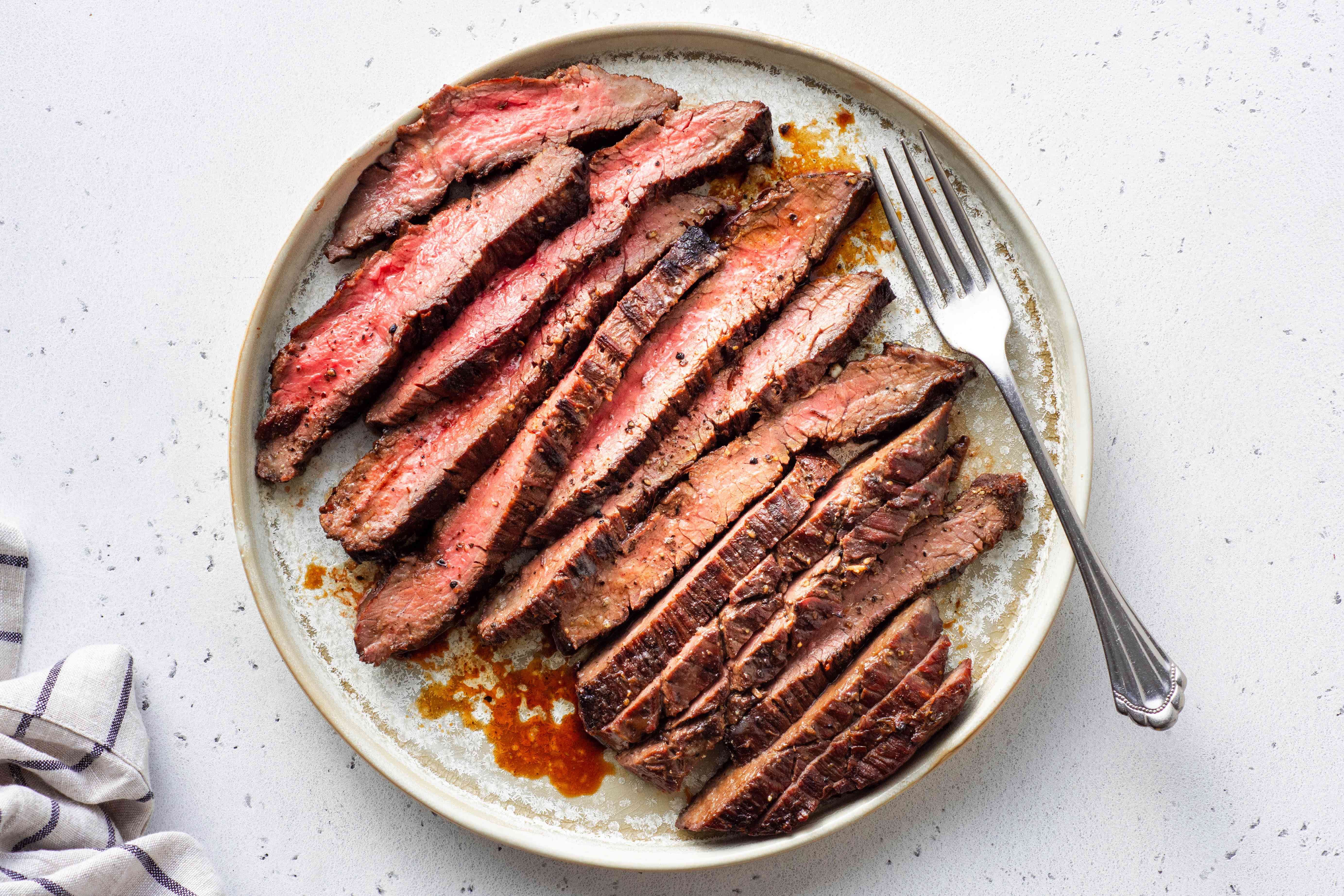 sliced Jack Daniel's Flank Steak on a plate