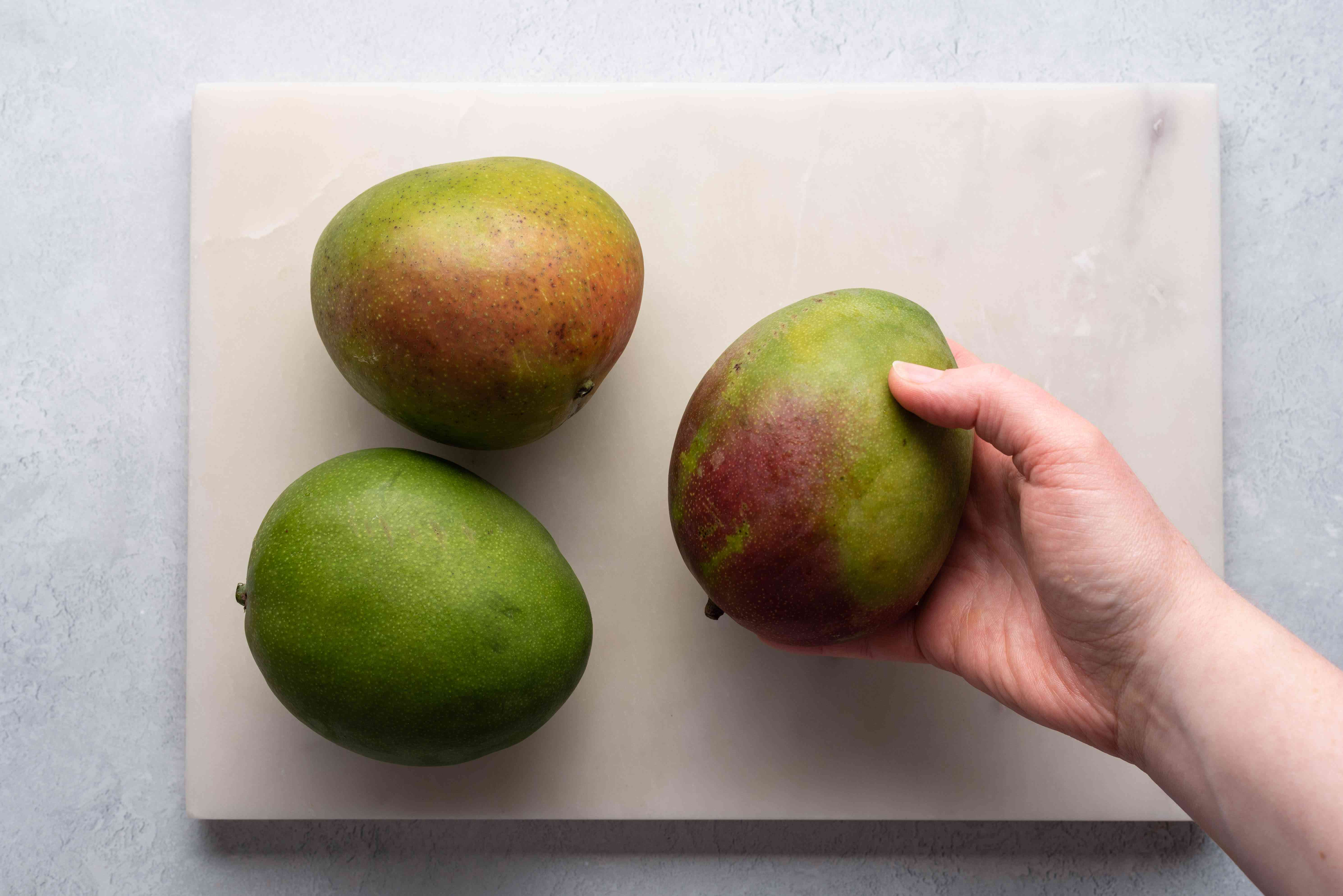 mangoes on a cutting board
