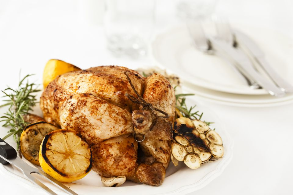 Roasted Chicken Dinner with Lemon, Potatoes, Carrots and Rosemary