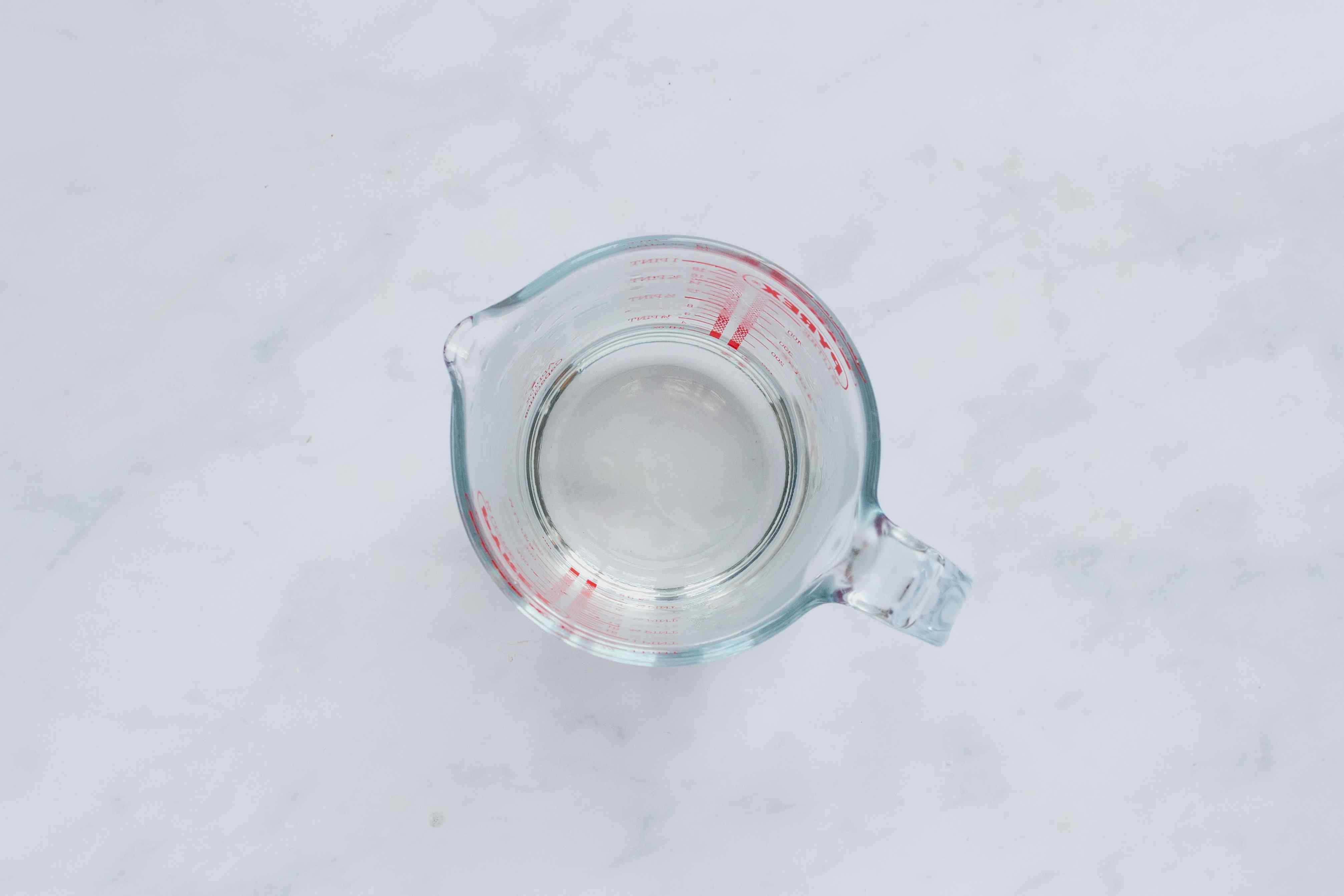 sugar and water mixture in a measuring cup