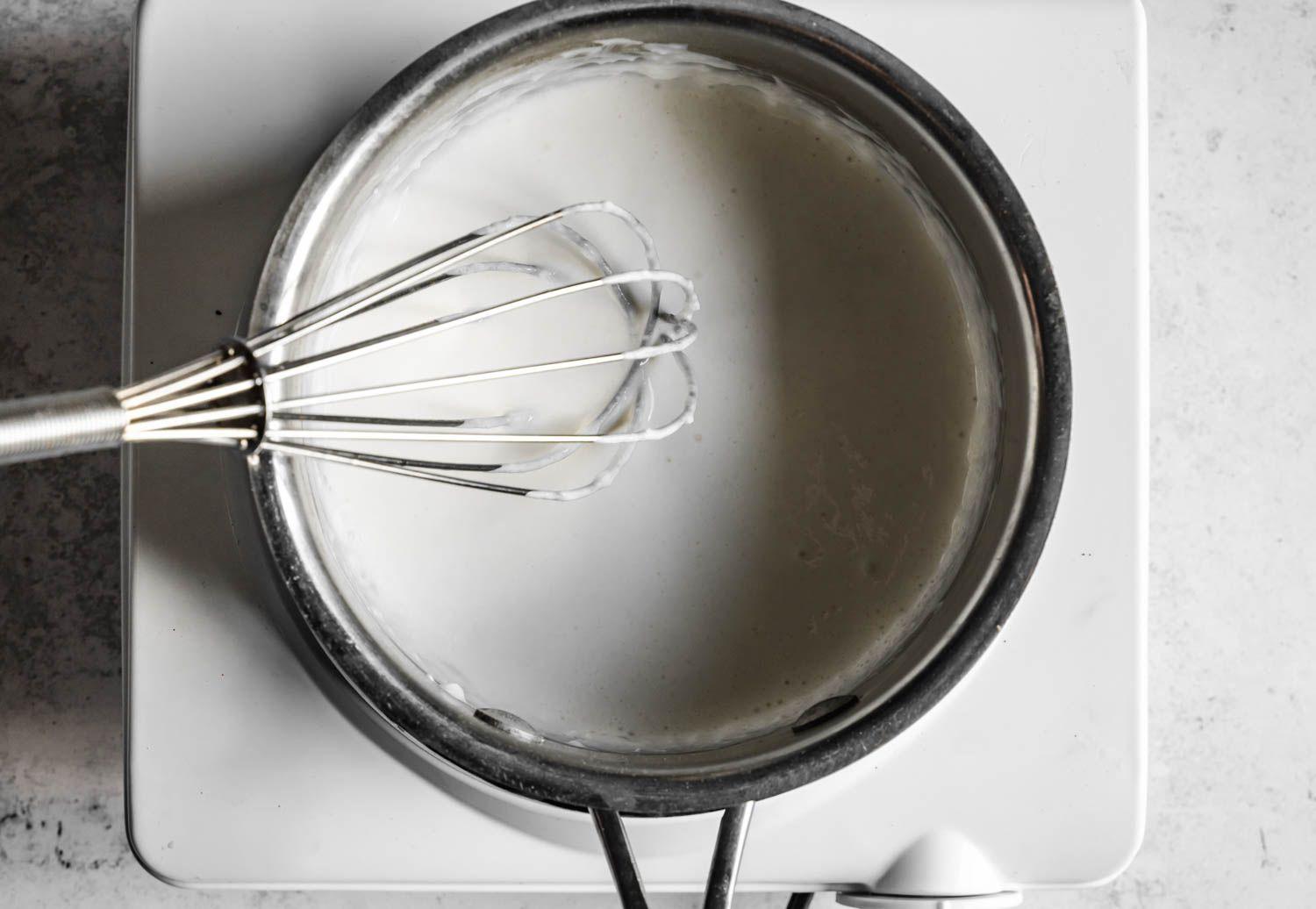 Whisk the milk, flour, and salt together in a saucepan