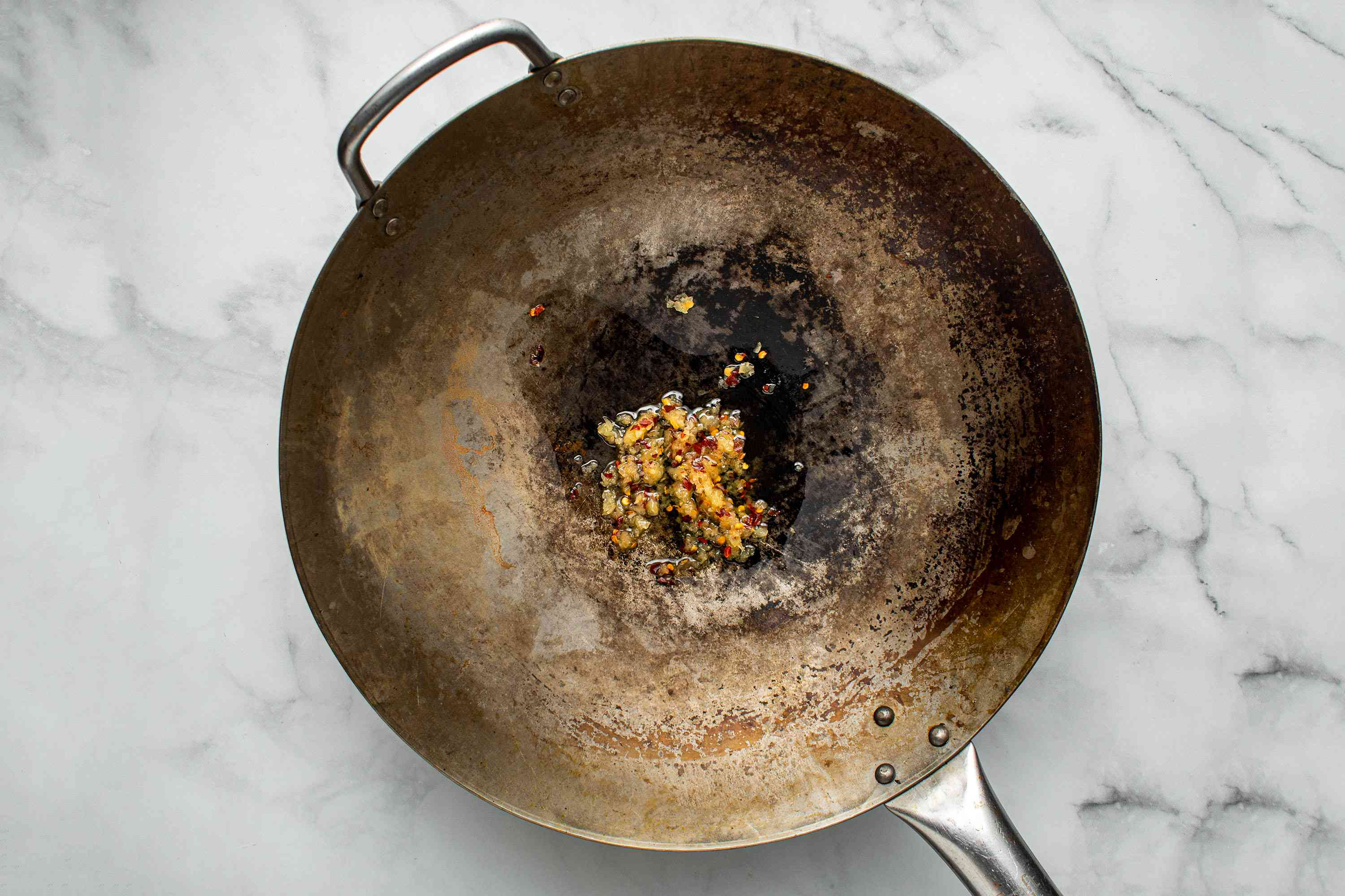 minced garlic and chili mixture in a wok