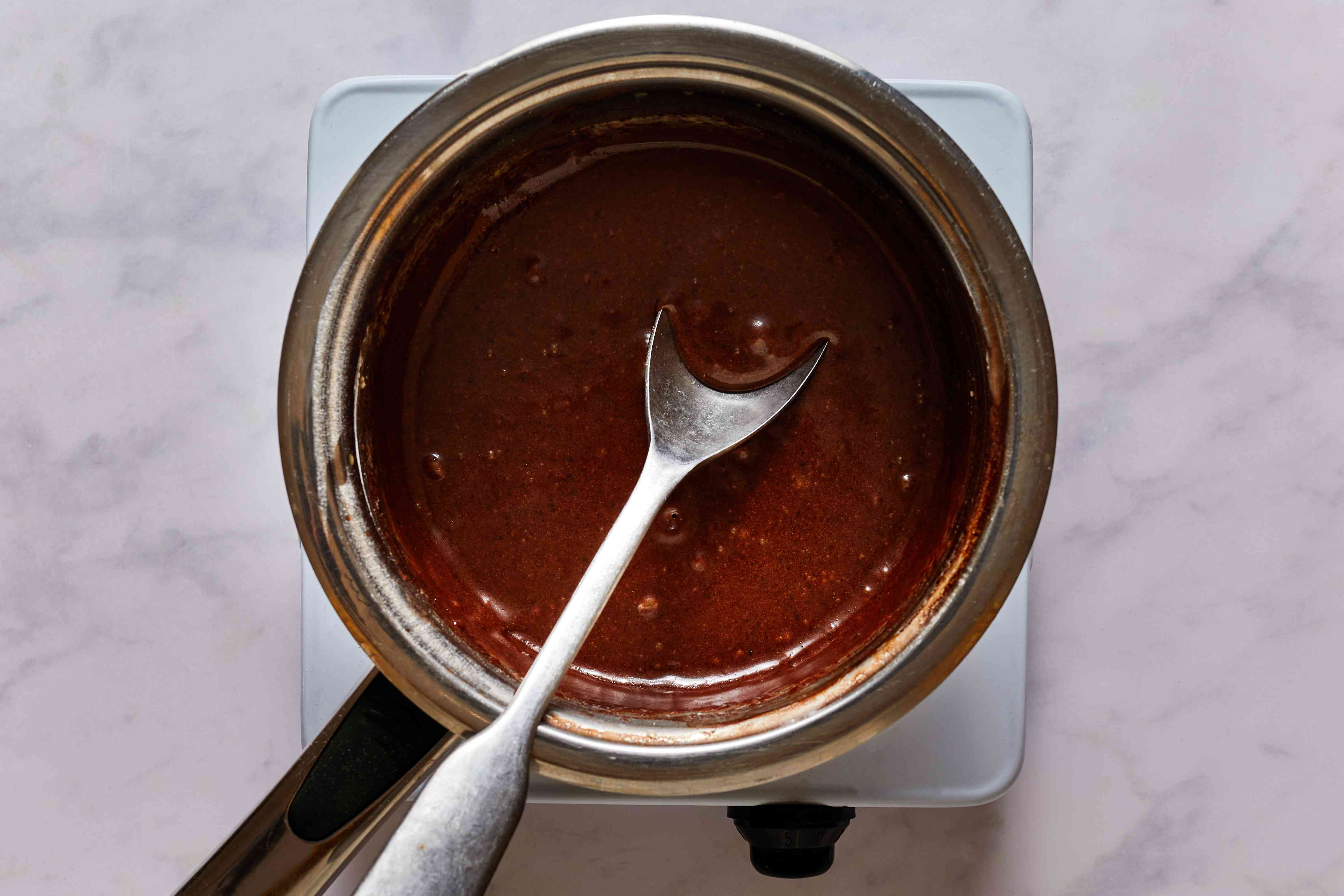 add powdered sugar and vanilla to the mixture in the saucepan