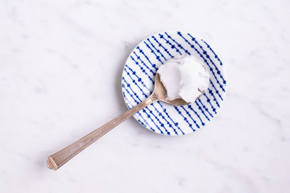 Coconut oil on a spoon and plate