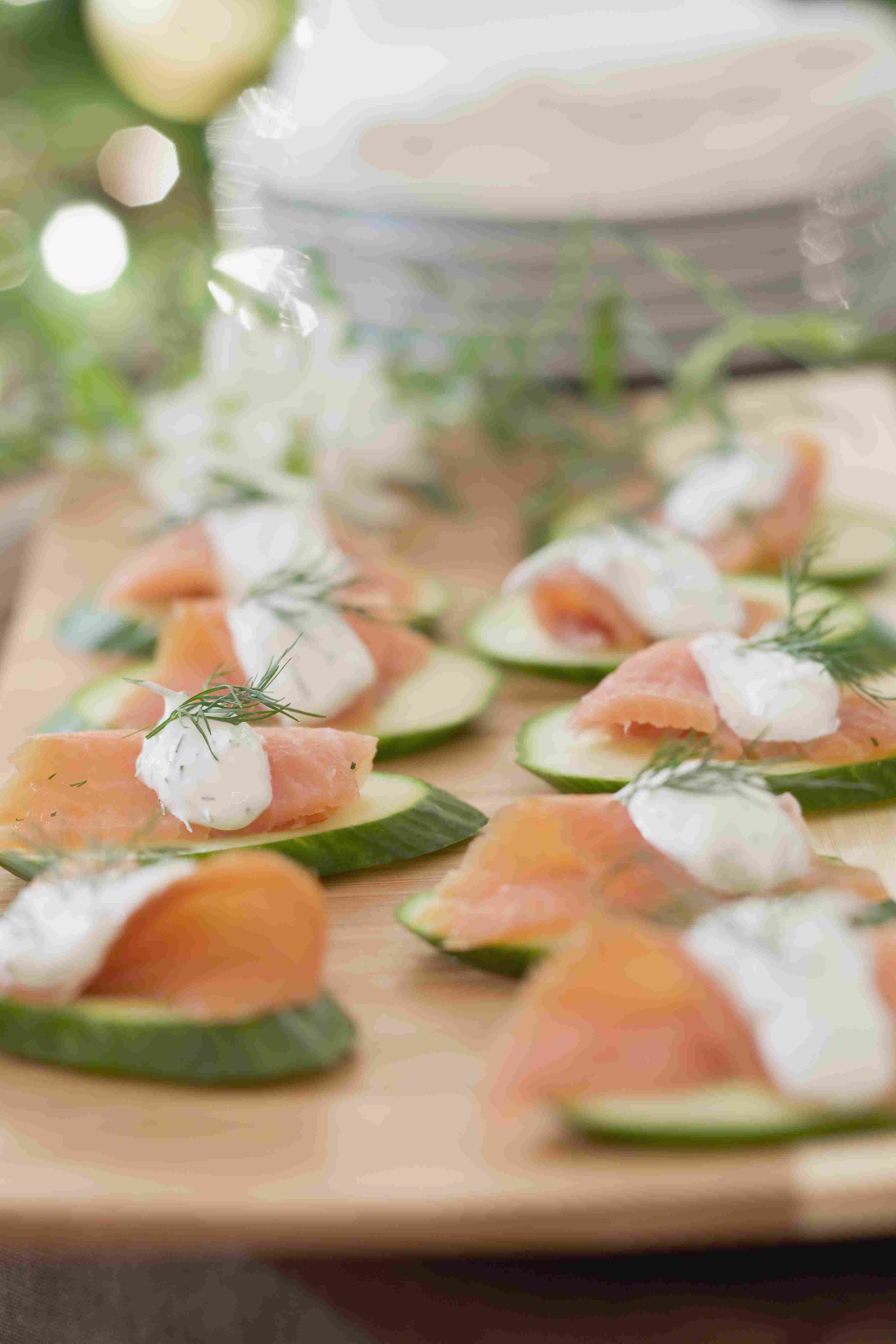 Smoked salmon with dill sauce and cucumbers