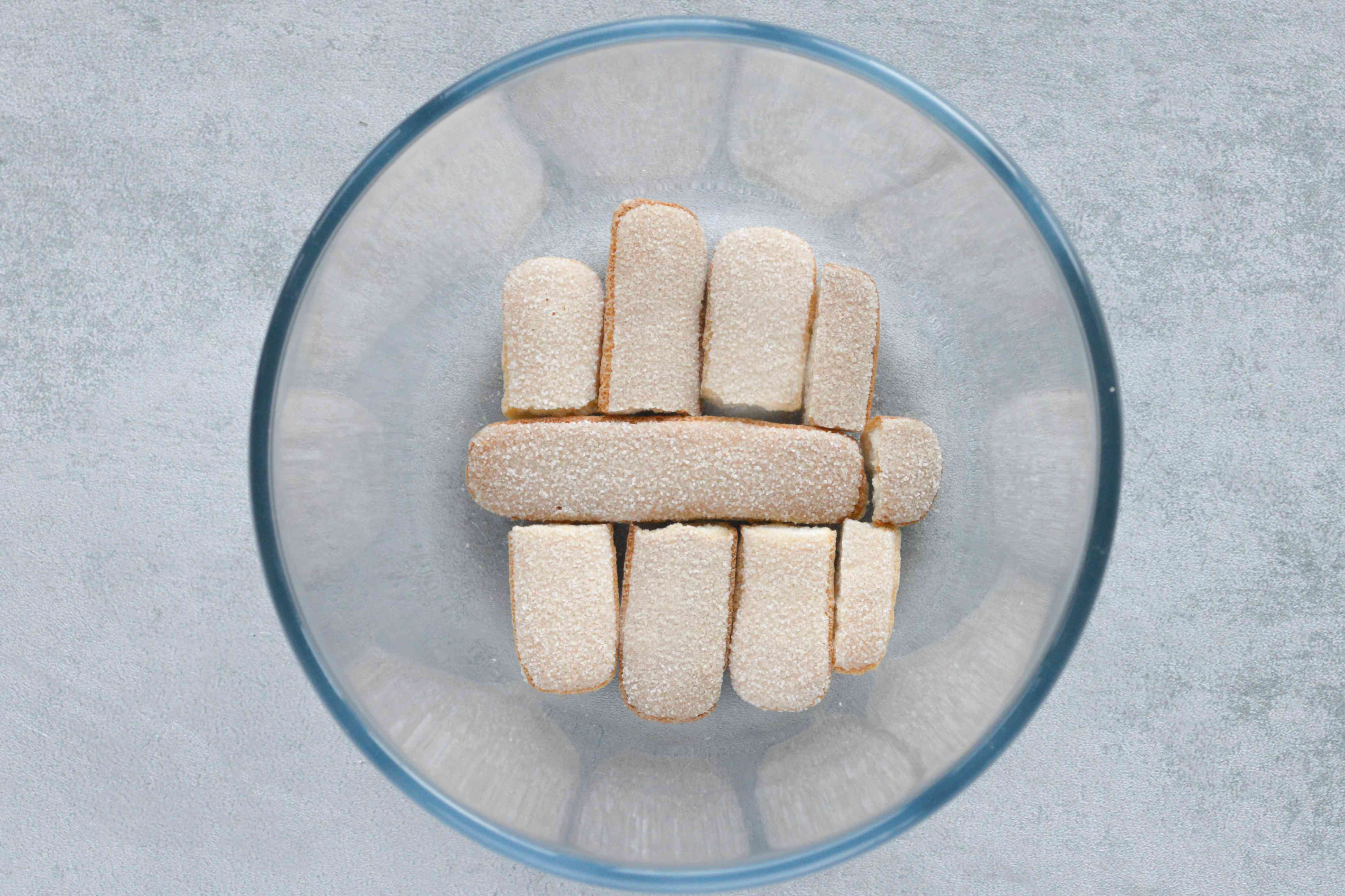 Line the bowl with sponge fingers or cake