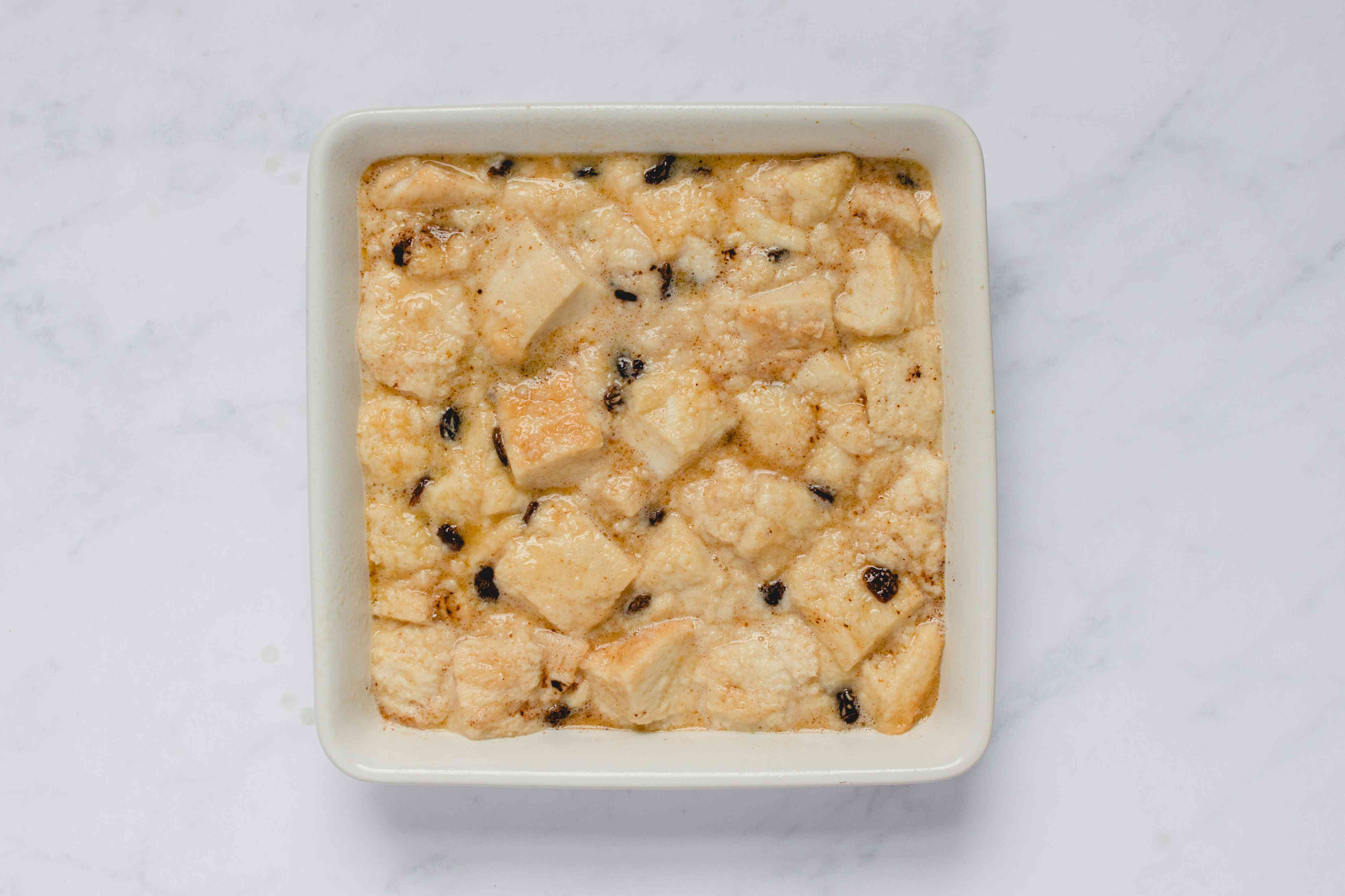 Pour the bread mix into the greased baking pan