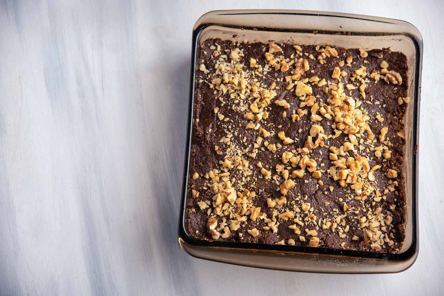 Spread brownie mixture in pan and top with walnuts