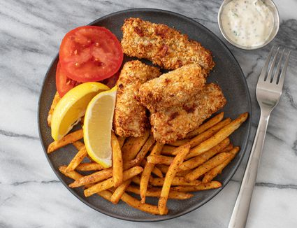 air fryer fish sticks with fries and tomato slices