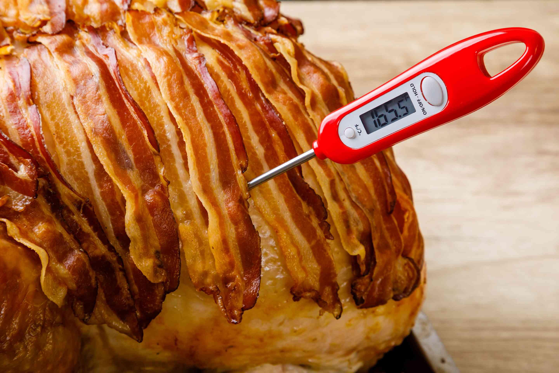 Take internal temperature of turkey