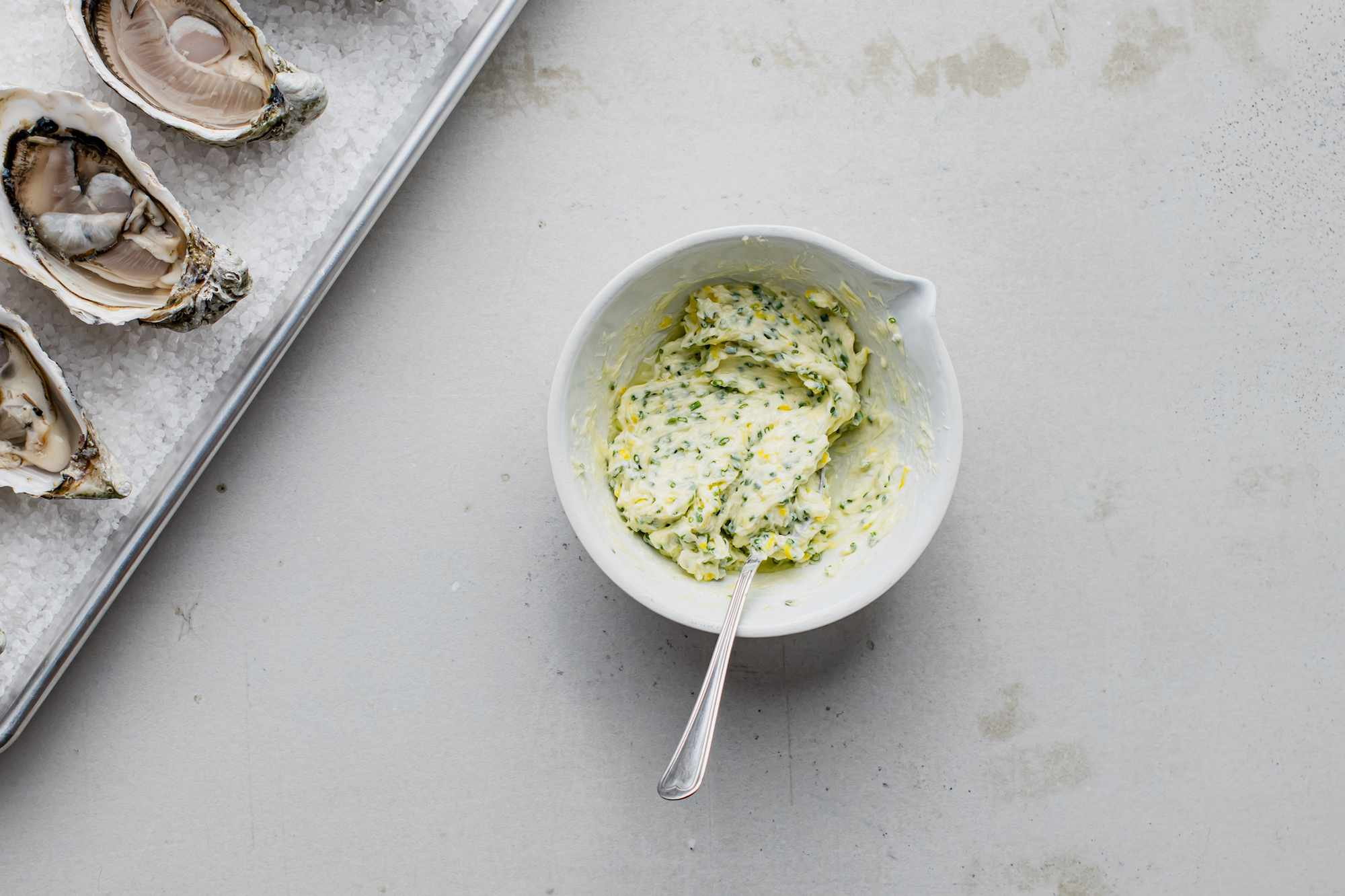 Herb and lemon butter in a bowl
