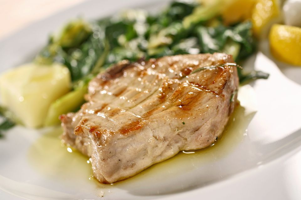 Grilled tuna steak with potatoes and chard