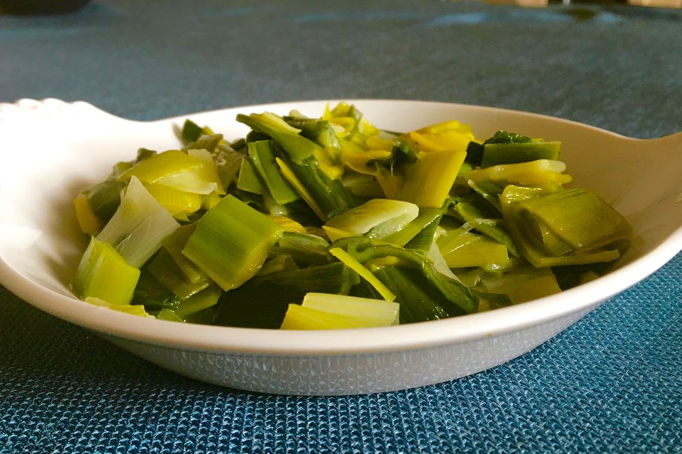 Butter-braised leeks in bowl