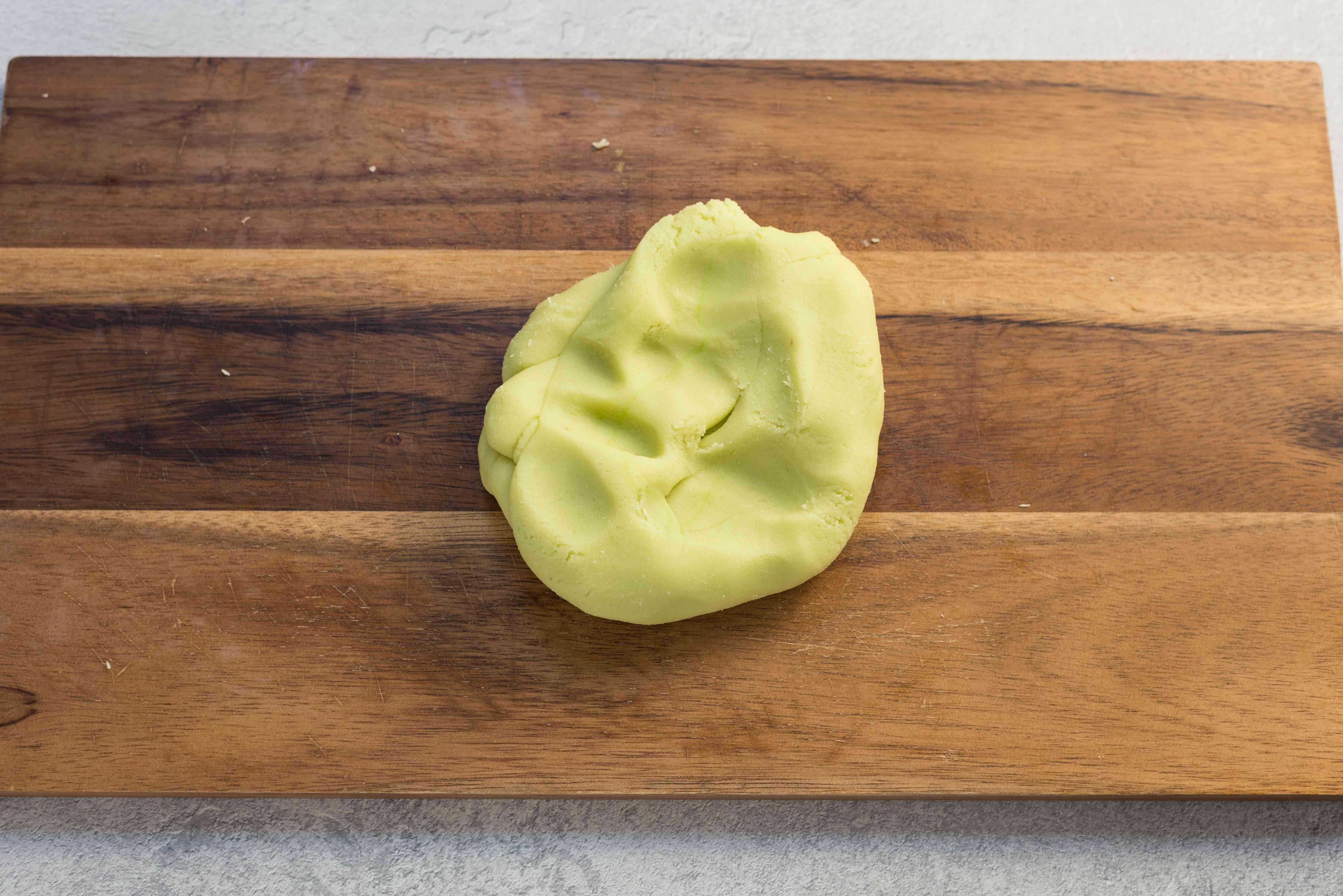 Knead green coloring into marzipan