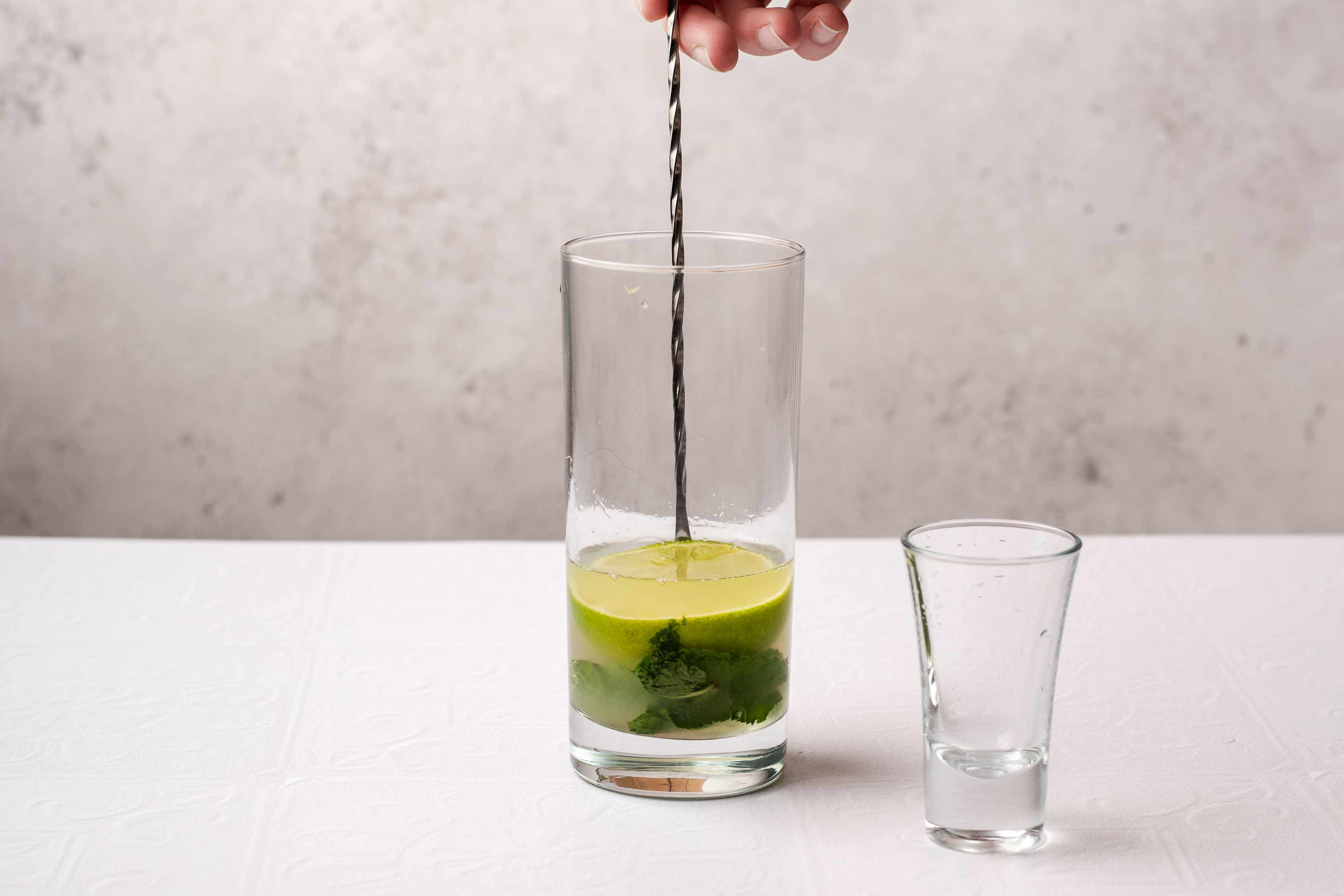 add rum to the mint mixture in the glass