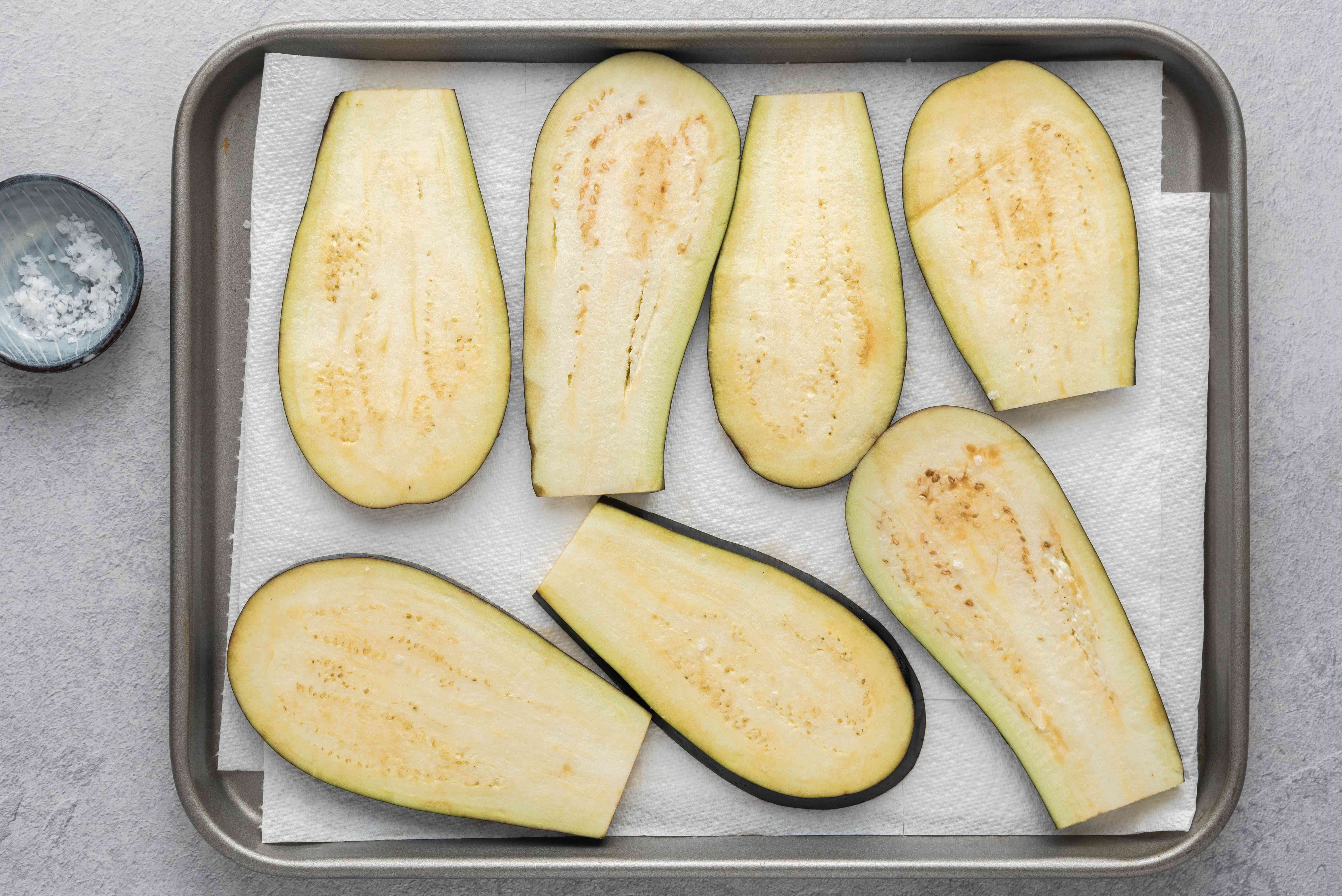 eggplant on top of a paper towel lined baking sheet