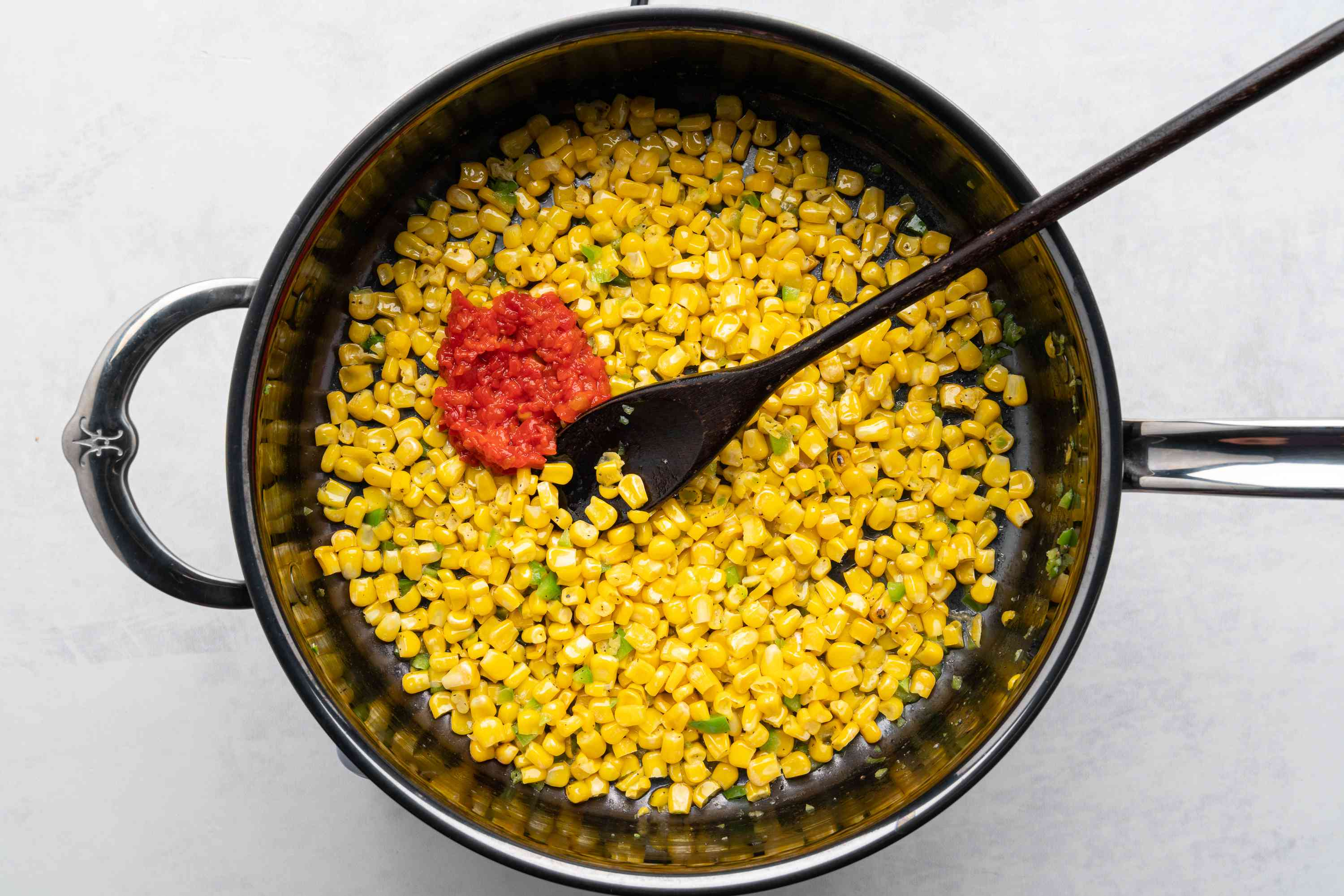 chopped pimiento with the corn mixture in the skillet