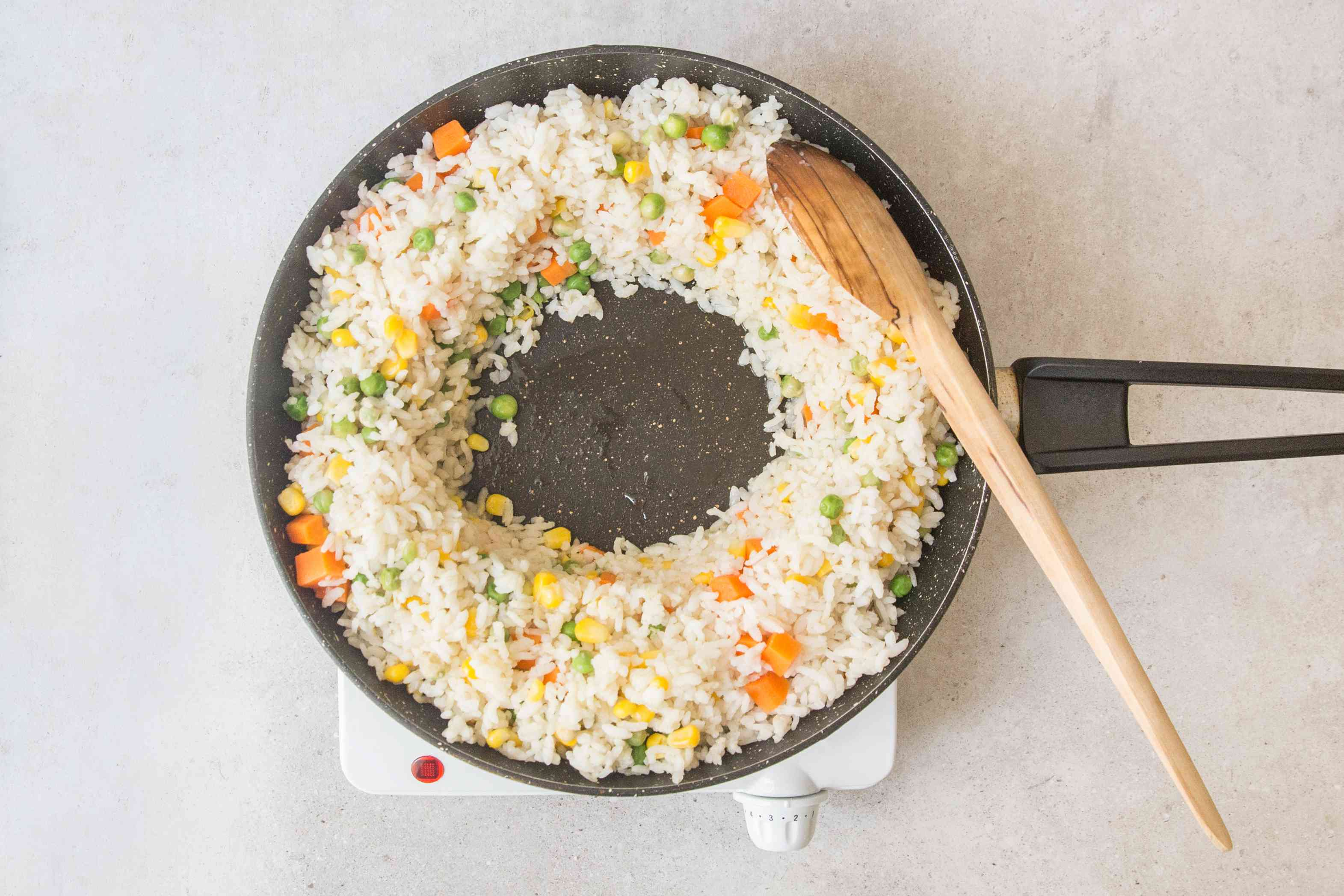 Push rice and vegetables in pan