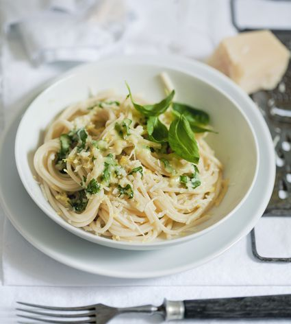 Spaghetti with cheese and basil, close-up