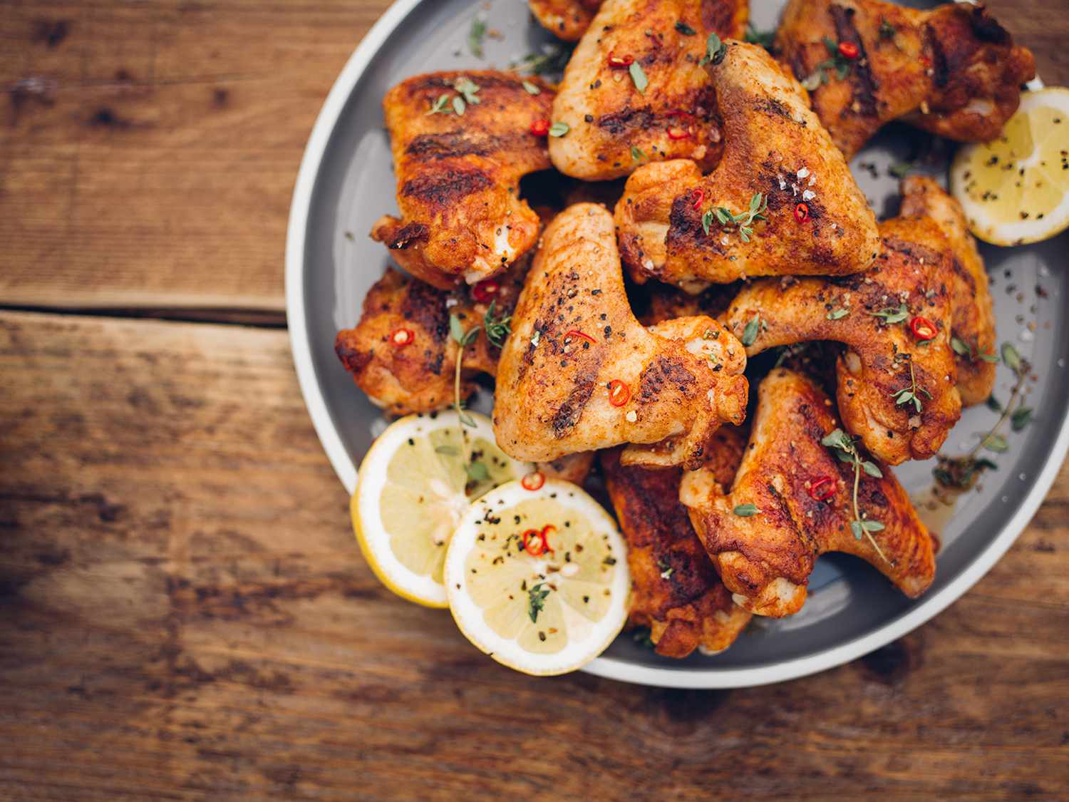 Crispy chillie sprinkled chicken wings on a plate