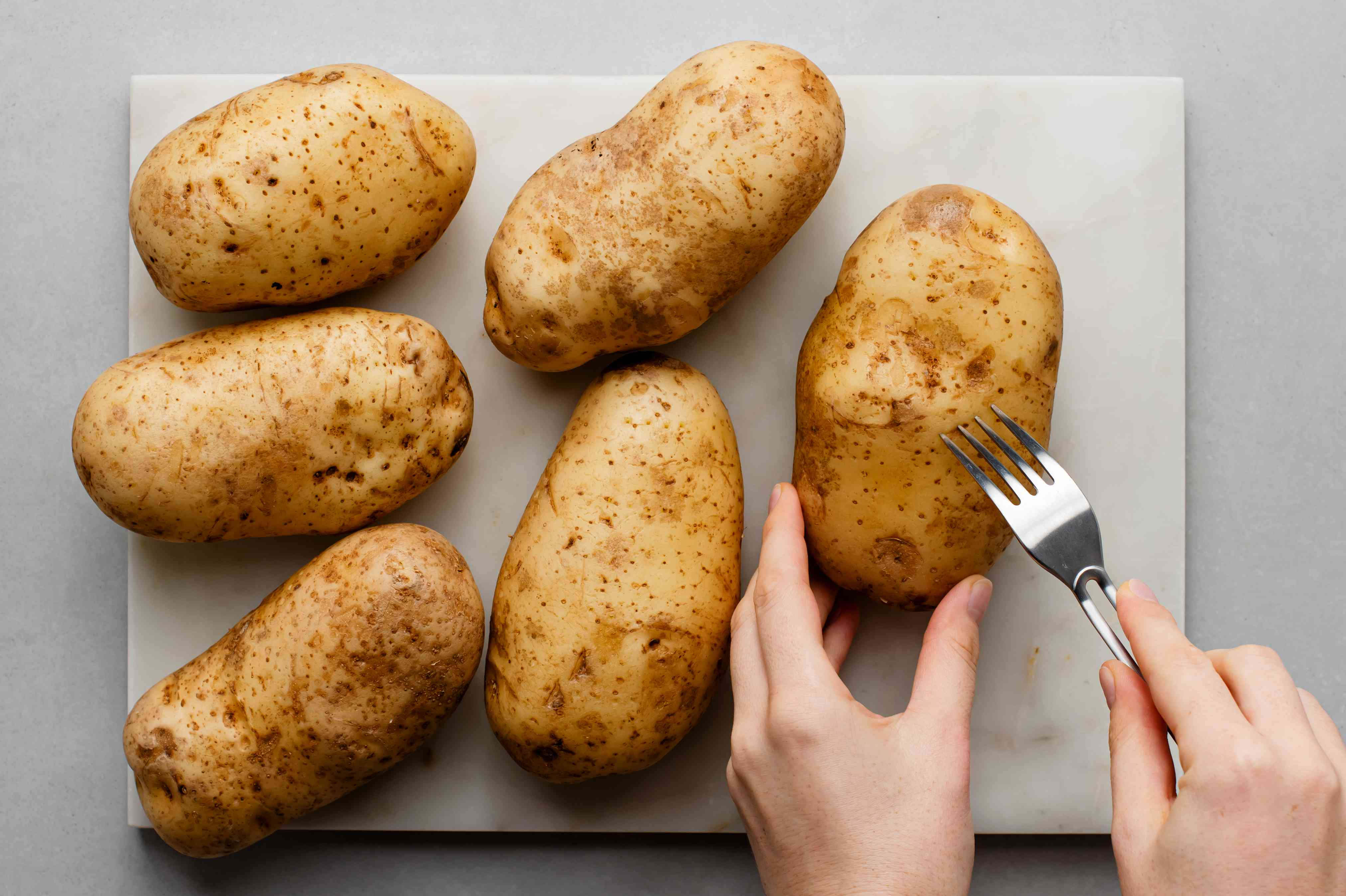 Prick the potatoes with a fork