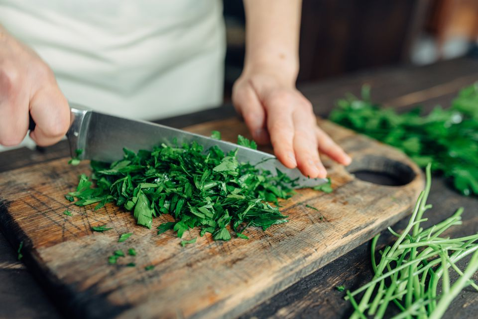 chopping herbs with knife