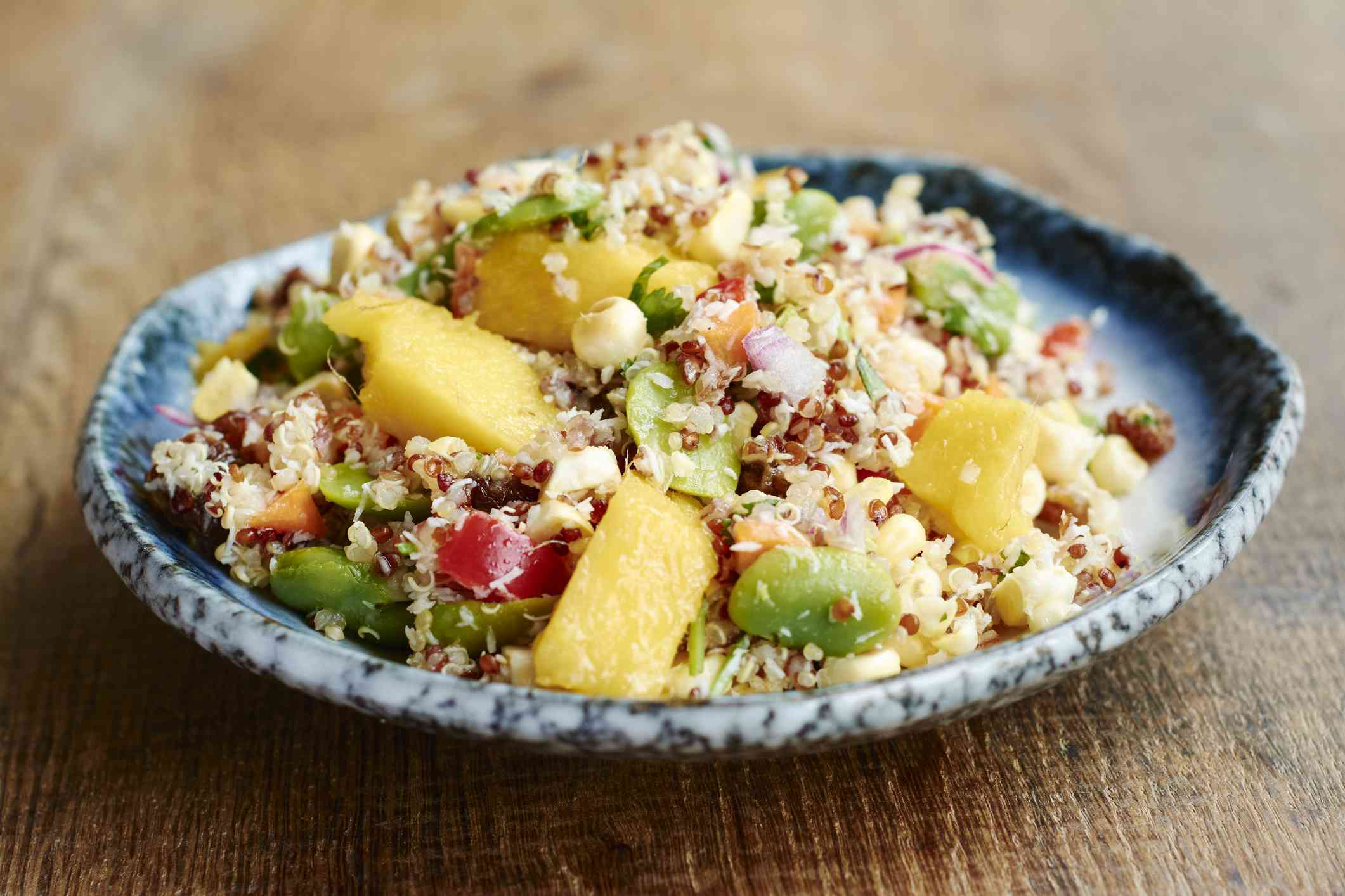 Quinoa salad with mango, beans, and onions