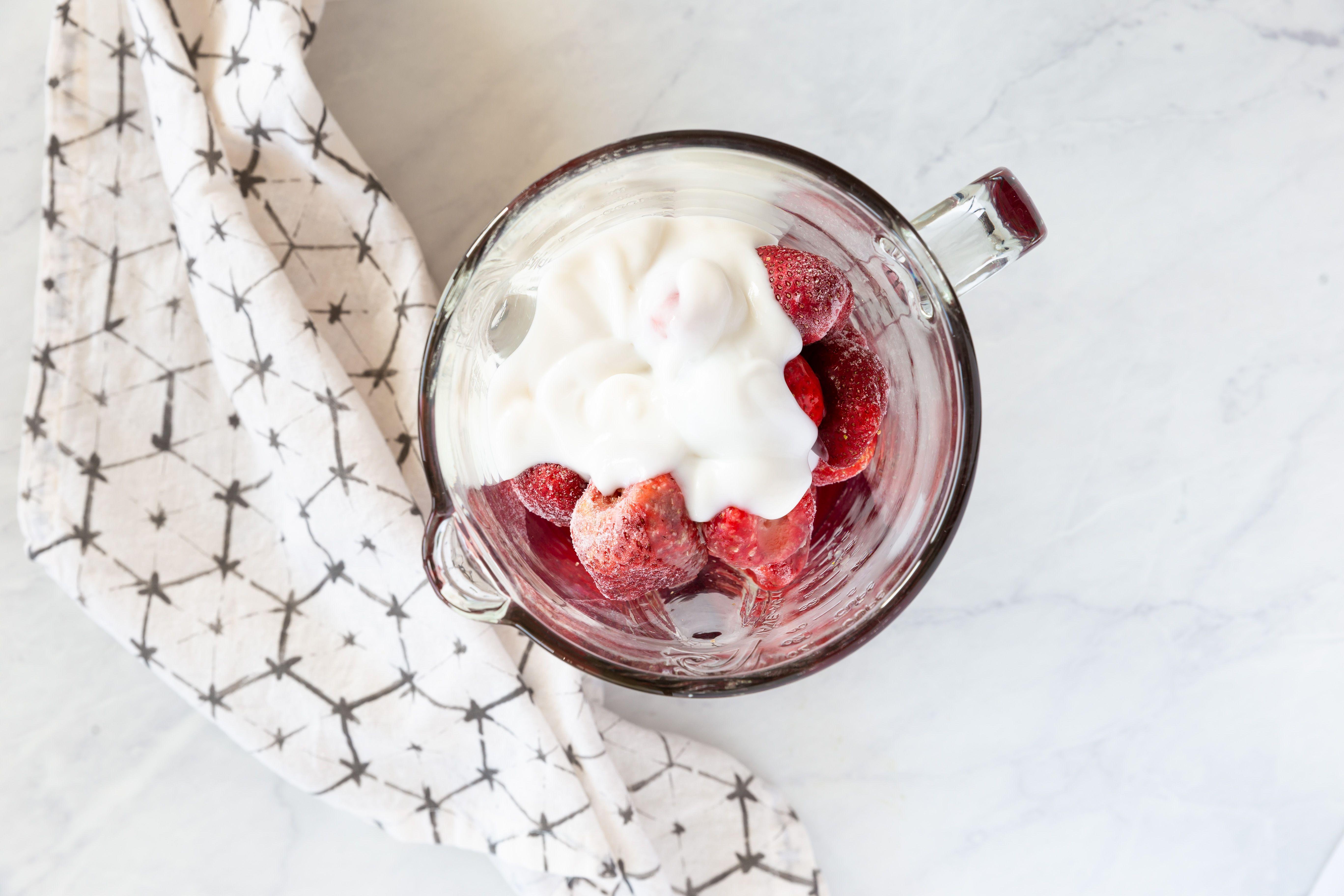Strawberry smoothie ingredients in a blender