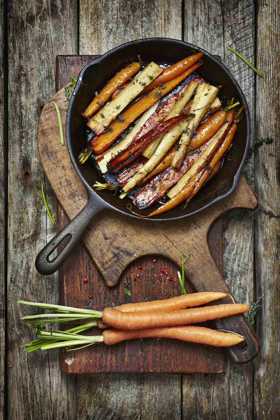 Honey roasted carrots and parsnips in a pan