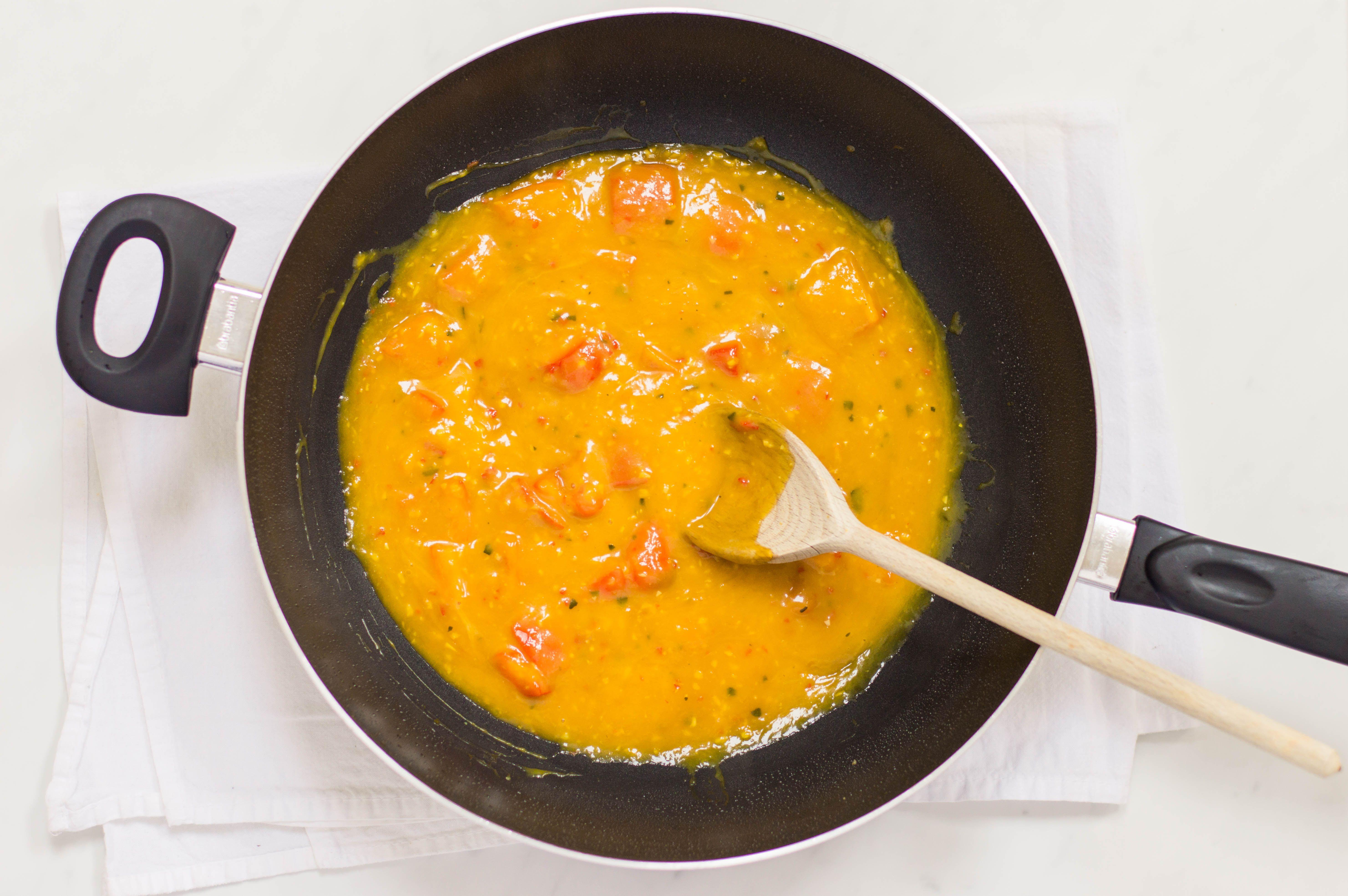 Thai Mango chicken sauce in a wok