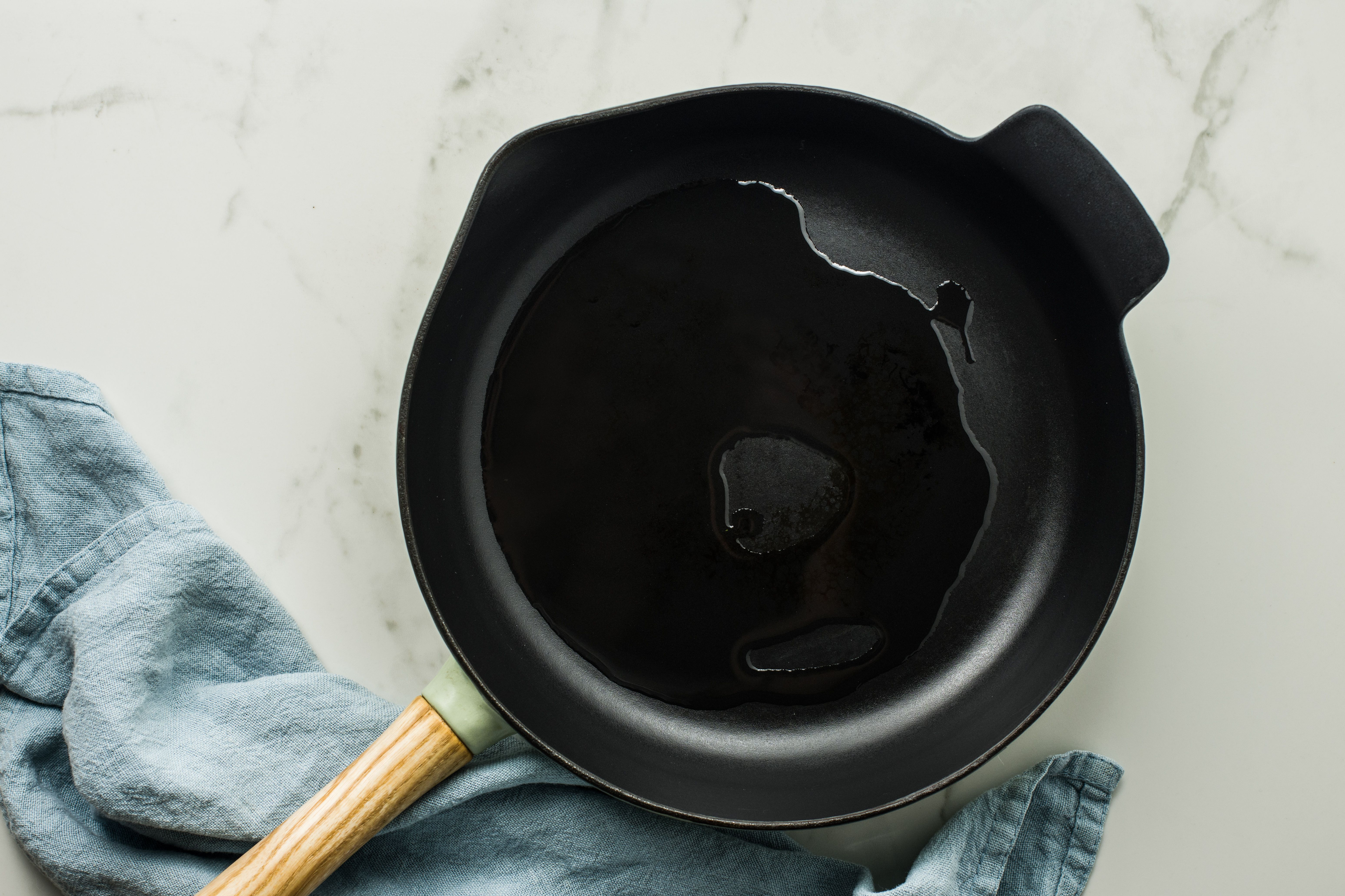 Oil heating in a cast iron skillet