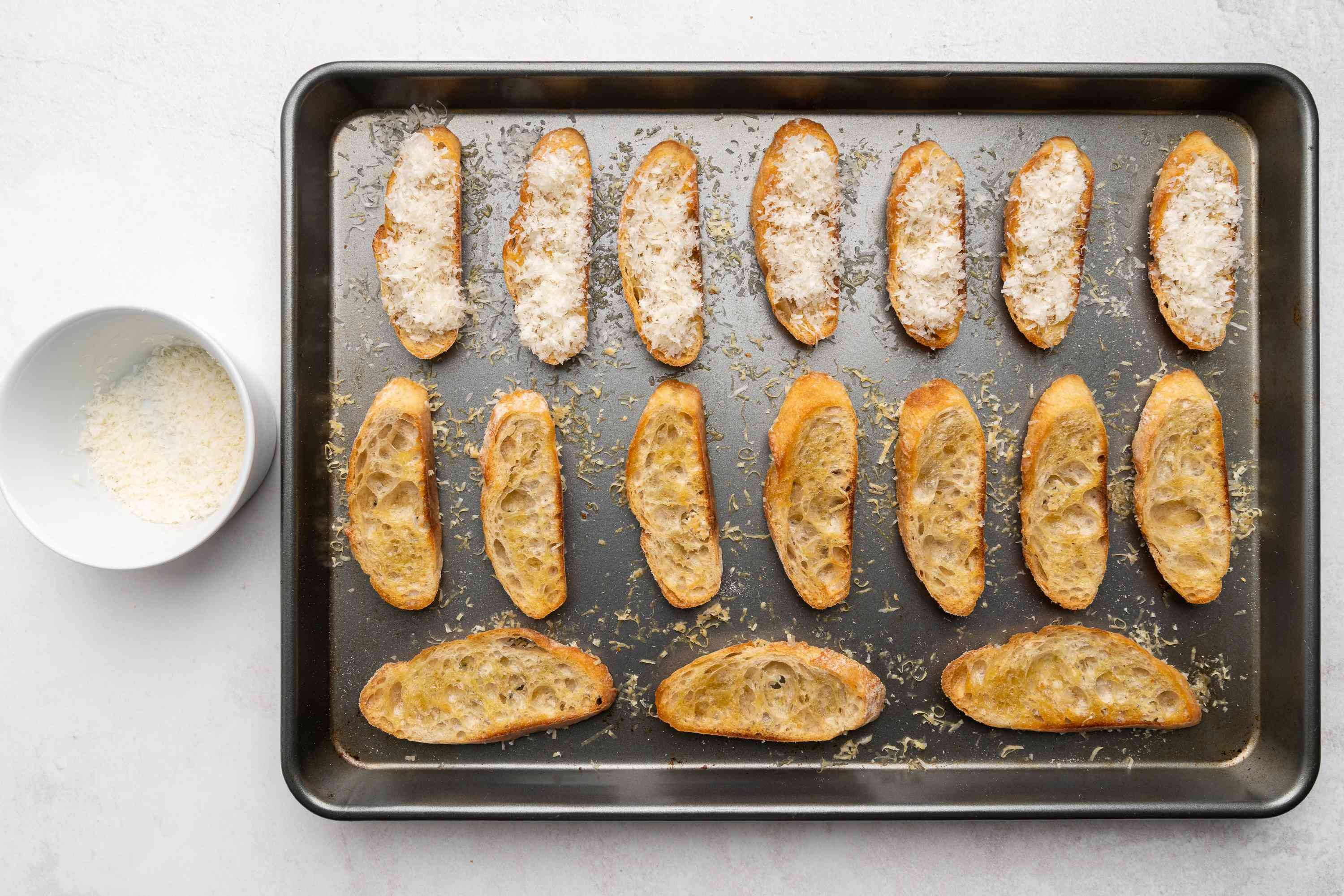 cheese and toast on a baking sheet