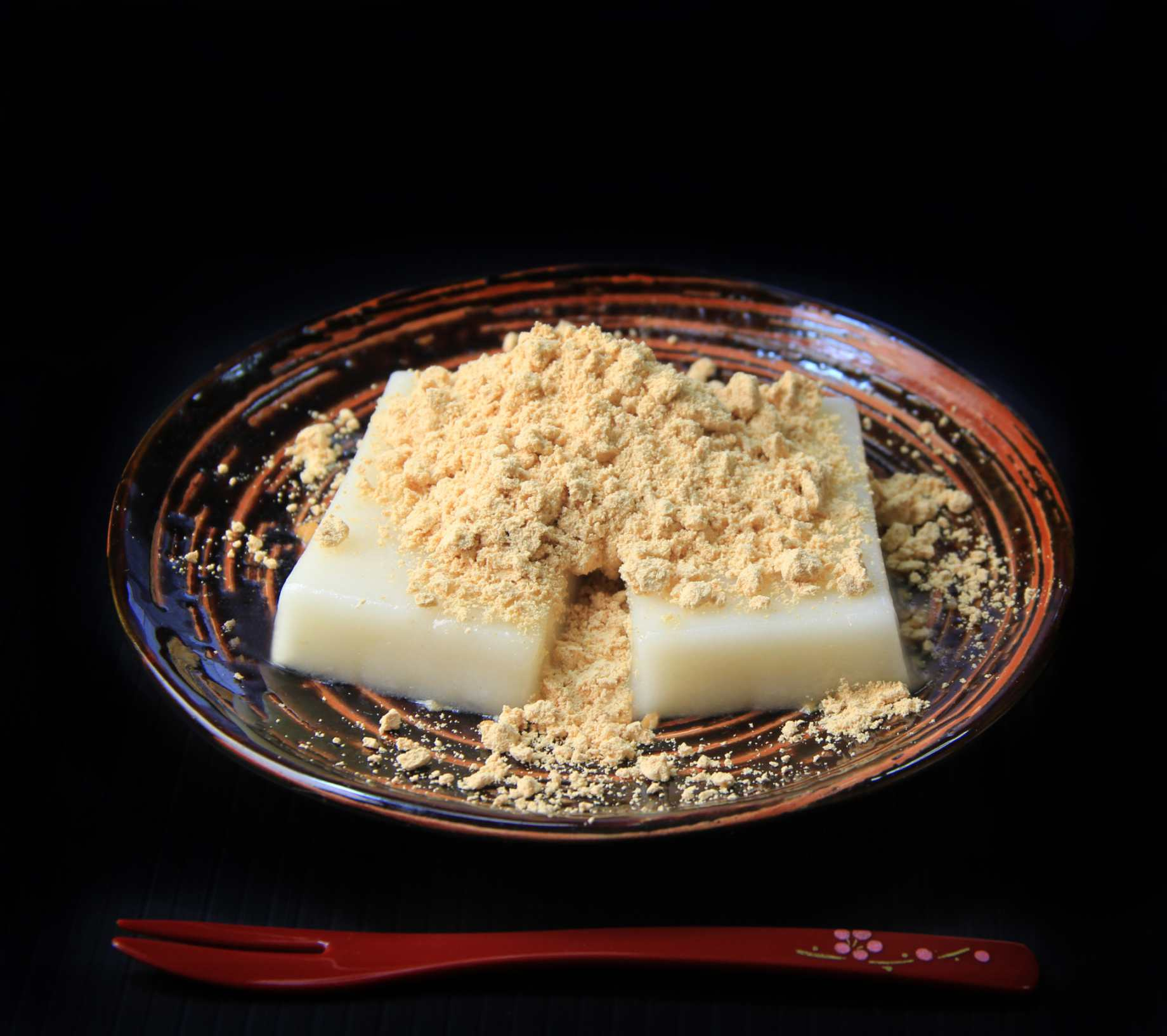 A plate of mochi dusted with sweet kinako