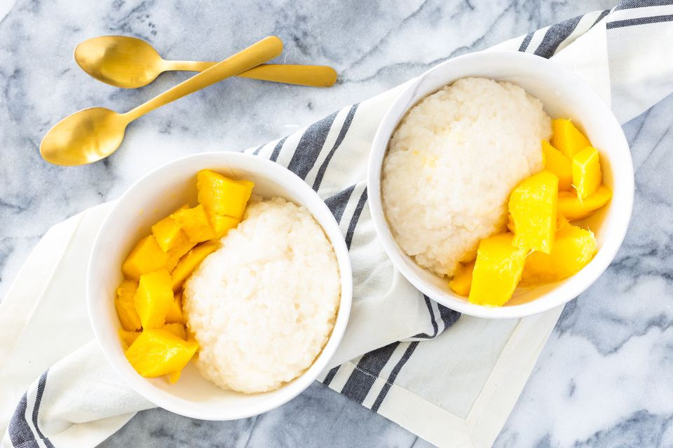 Bowls of Thai mango sticky rice with fresh sliced mango