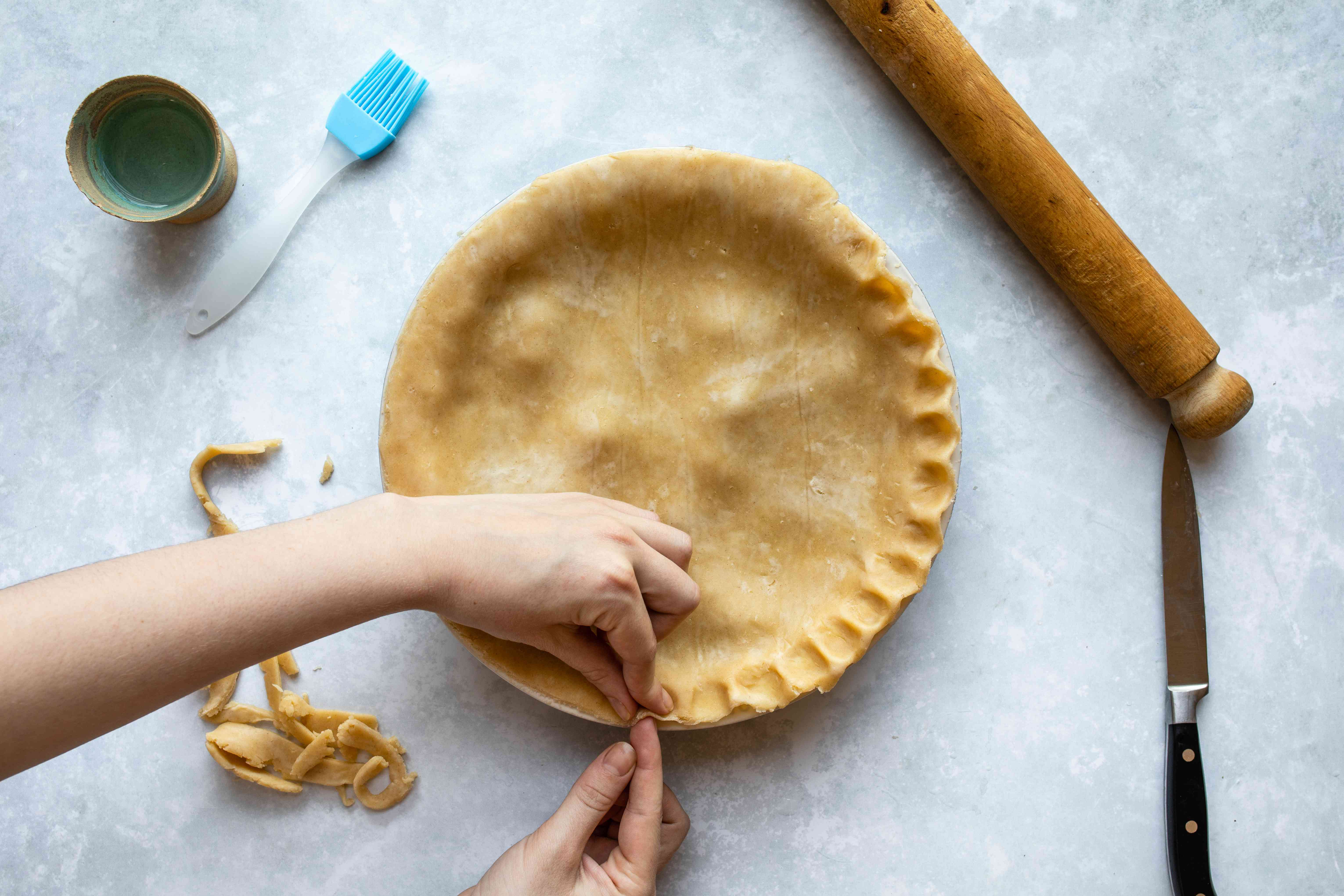 Crimping edges of dough