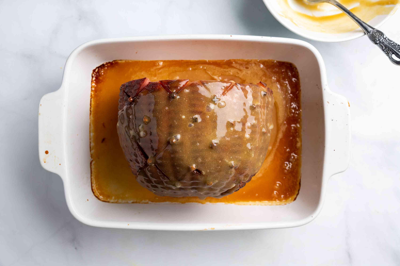 ham in pan with honey butter mixture