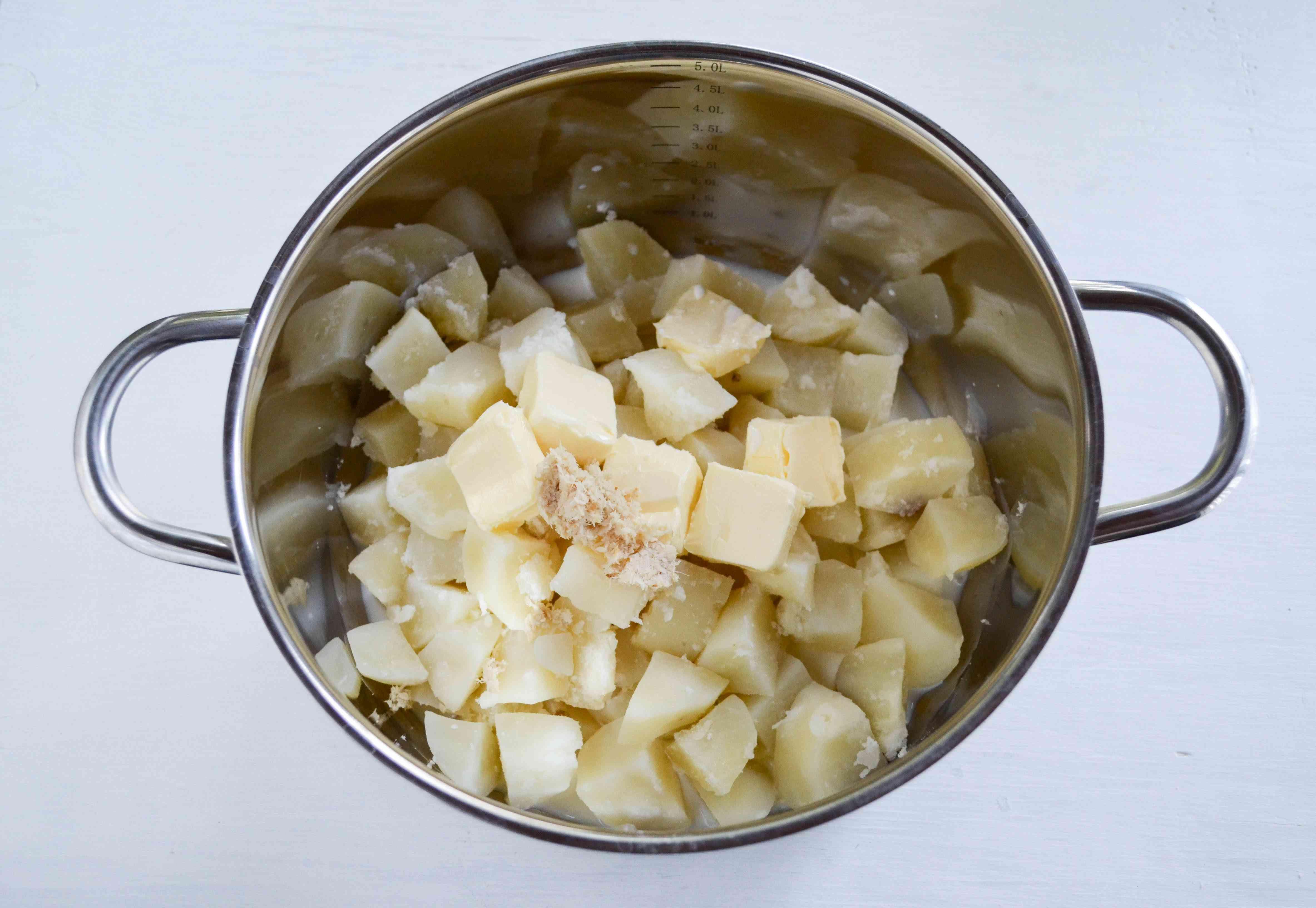 Add the butter, milk, yogurt, and horseradish