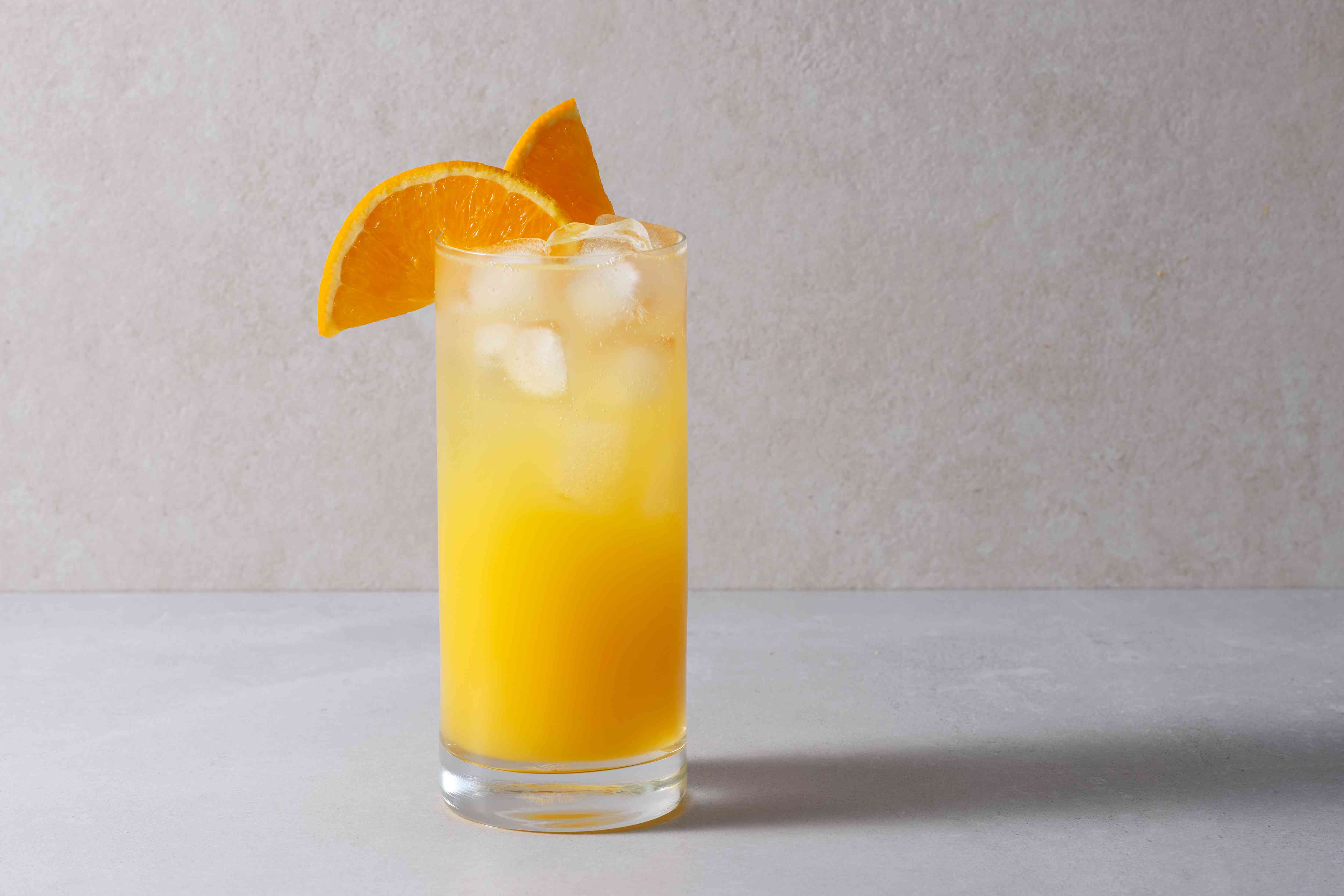 The Bocce Ball in a glass, garnished with orange slices